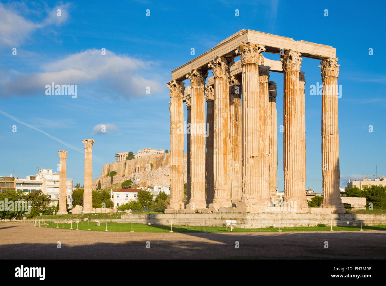 Athens - The Olympieion in morning dusk and the Acropolis in the background - Stock Image