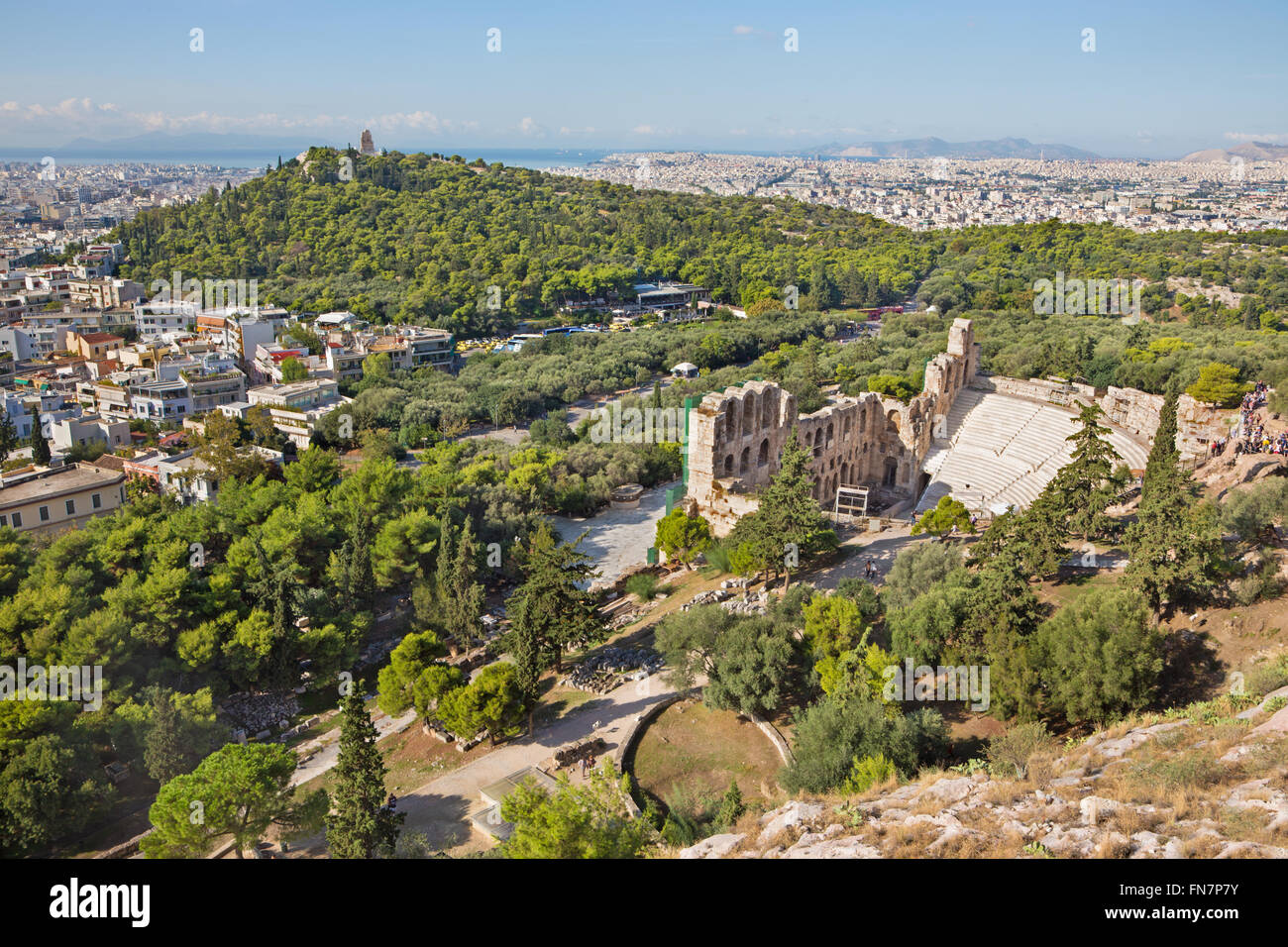 Athens - The Odeon of Herodes Atticus or Herodeon under The Acropolis in morning light and the town panorama - Stock Image