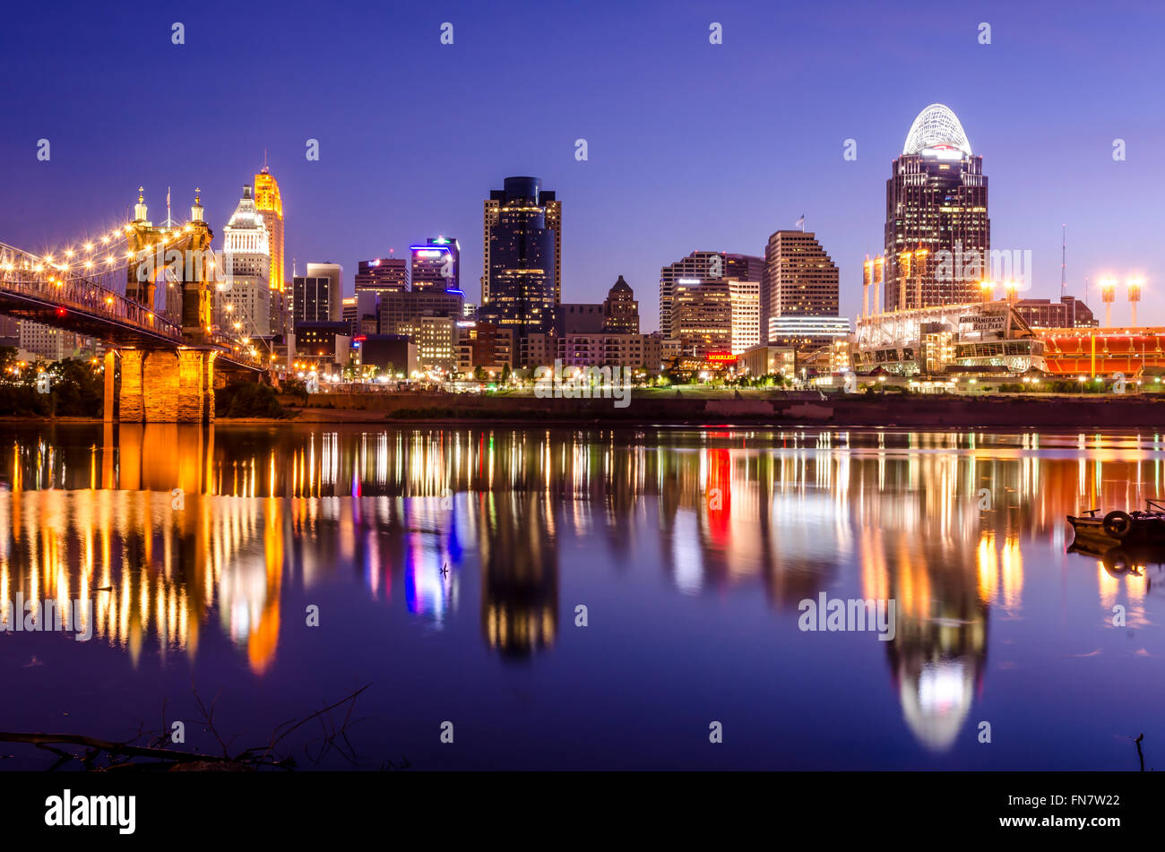 Cincinnati skyline at dawn with reflections from the building in the River Ohio - Stock Image