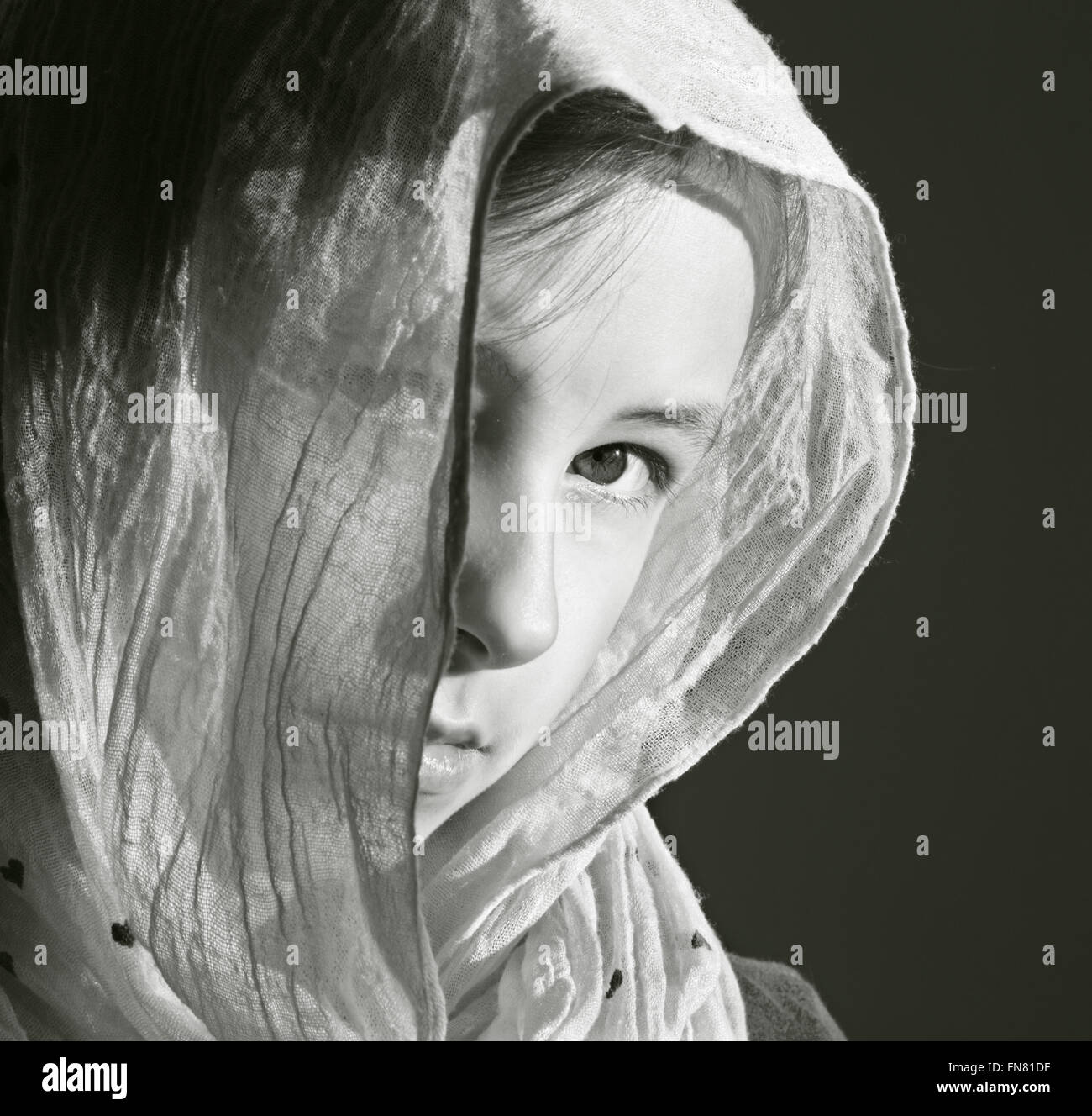The portrait of young girl in the headcloth - Stock Image