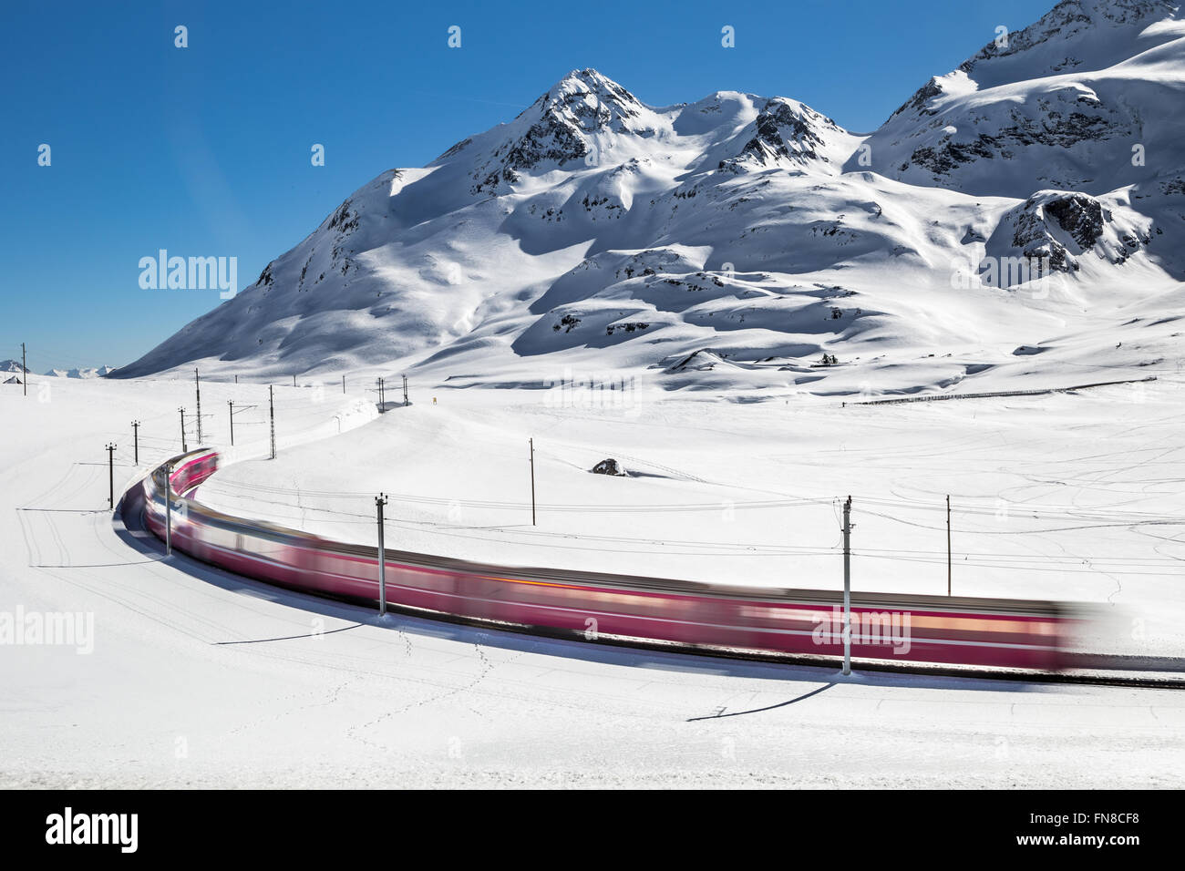 Bernina Express train, railway between Italy and Switzerland - Stock Image