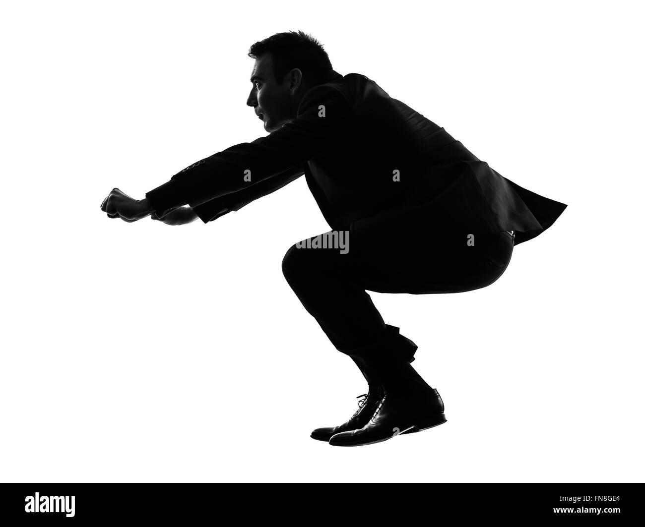 one caucasian business man driving imaginary motorcycle in silhouette on white background - Stock Image