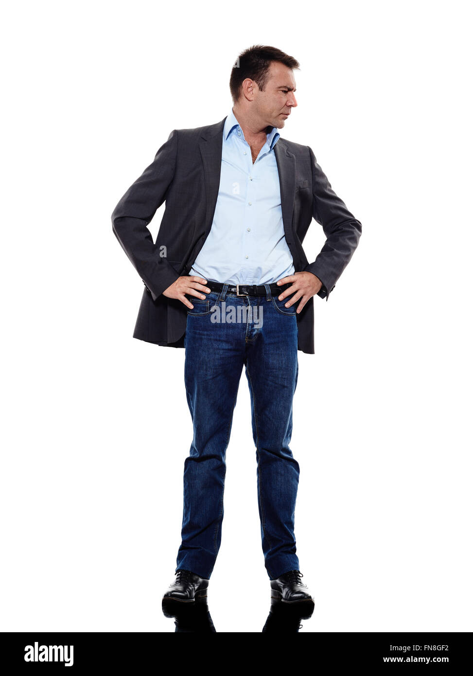 one caucasian business man standing mocking in silhouette on white background - Stock Image