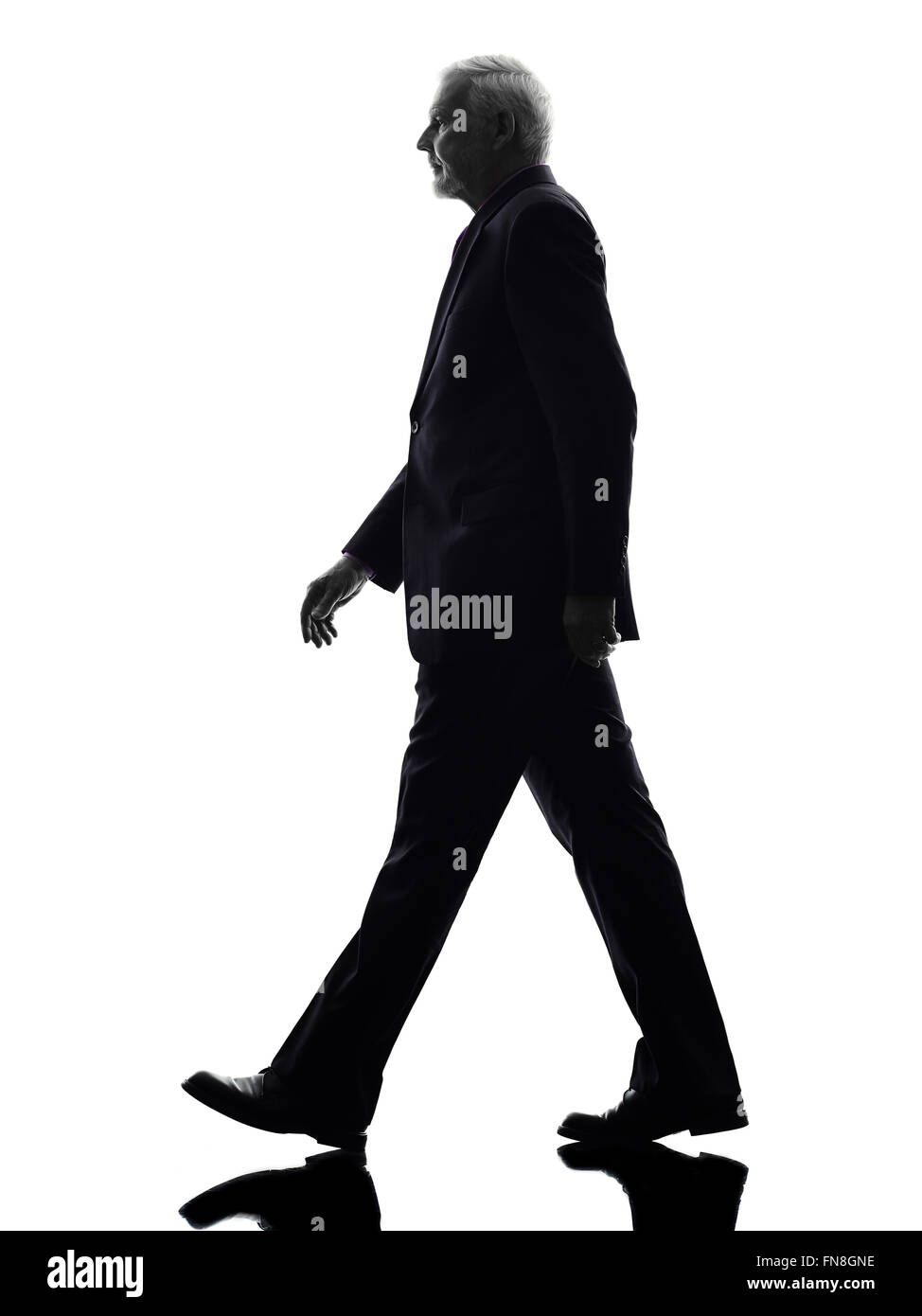 One Caucasian Senior Business Man walking Silhouette White Background - Stock Image