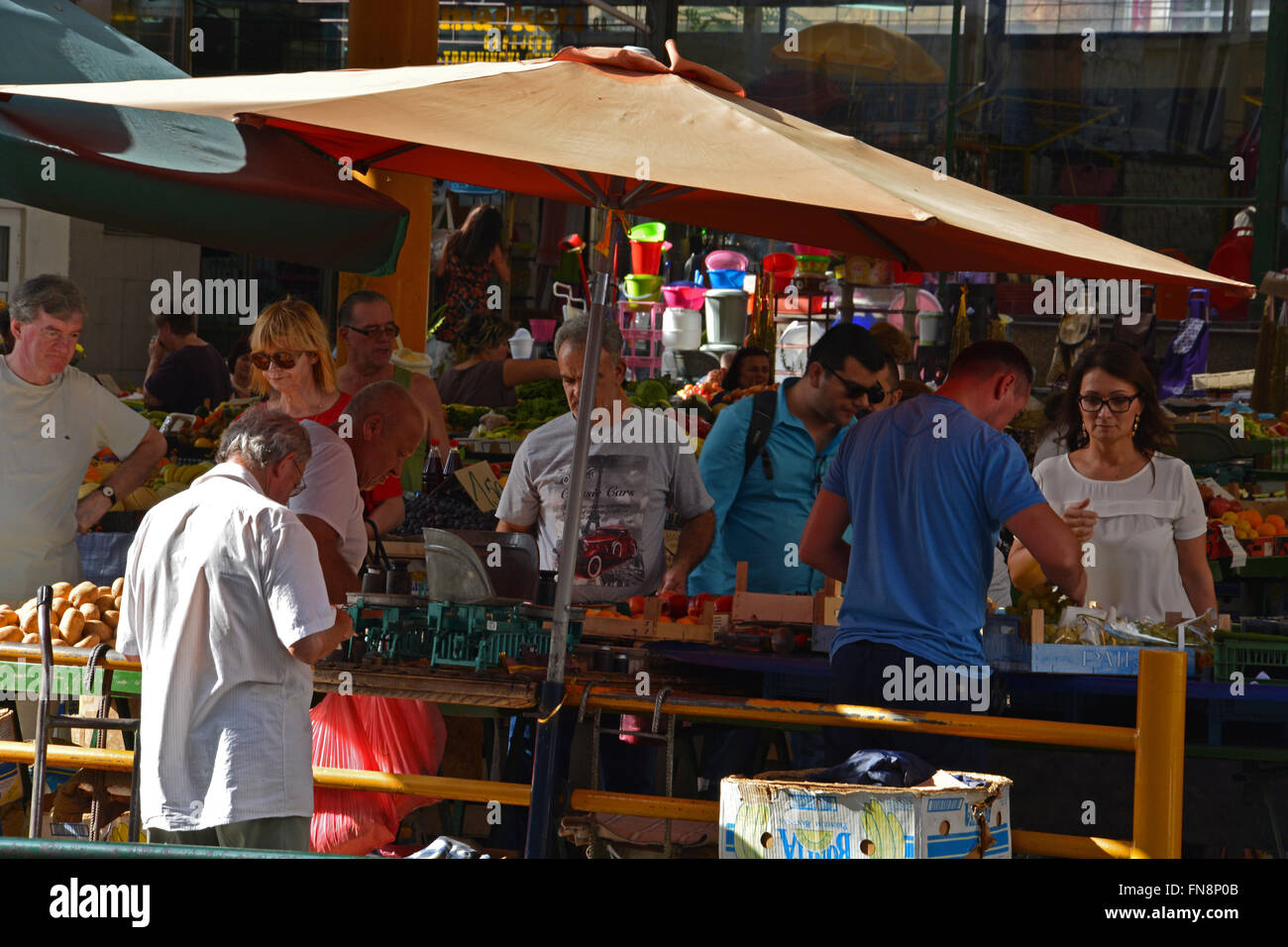 Vendors sell produce in the Green Market in the Old Town section of Sarajevo, Bosnia and Herzegovina. - Stock Image