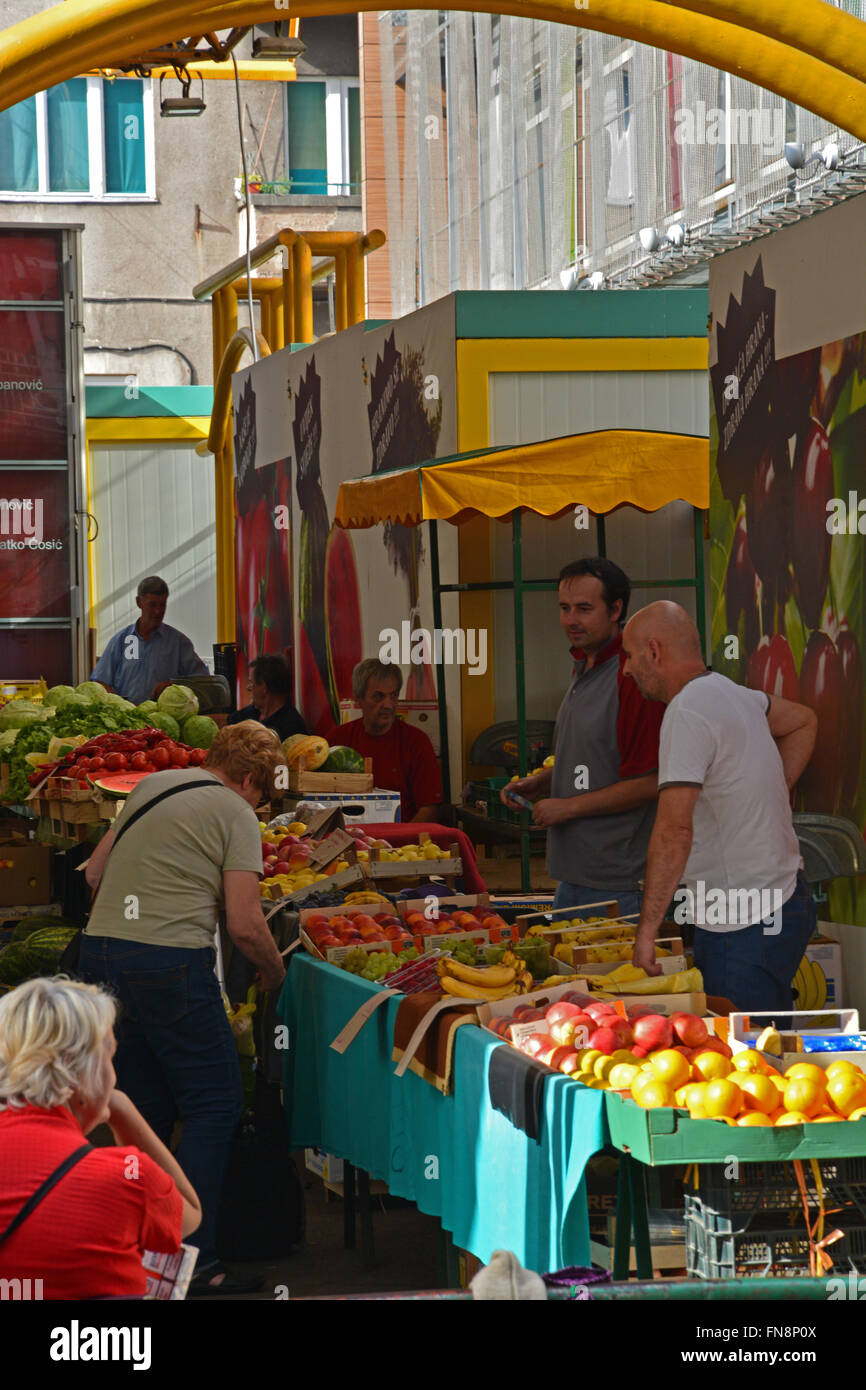 Vendors sell produce in the Green Market in the Old Town section of Sarajevo, Bosnia and Herzegovina. Stock Photo