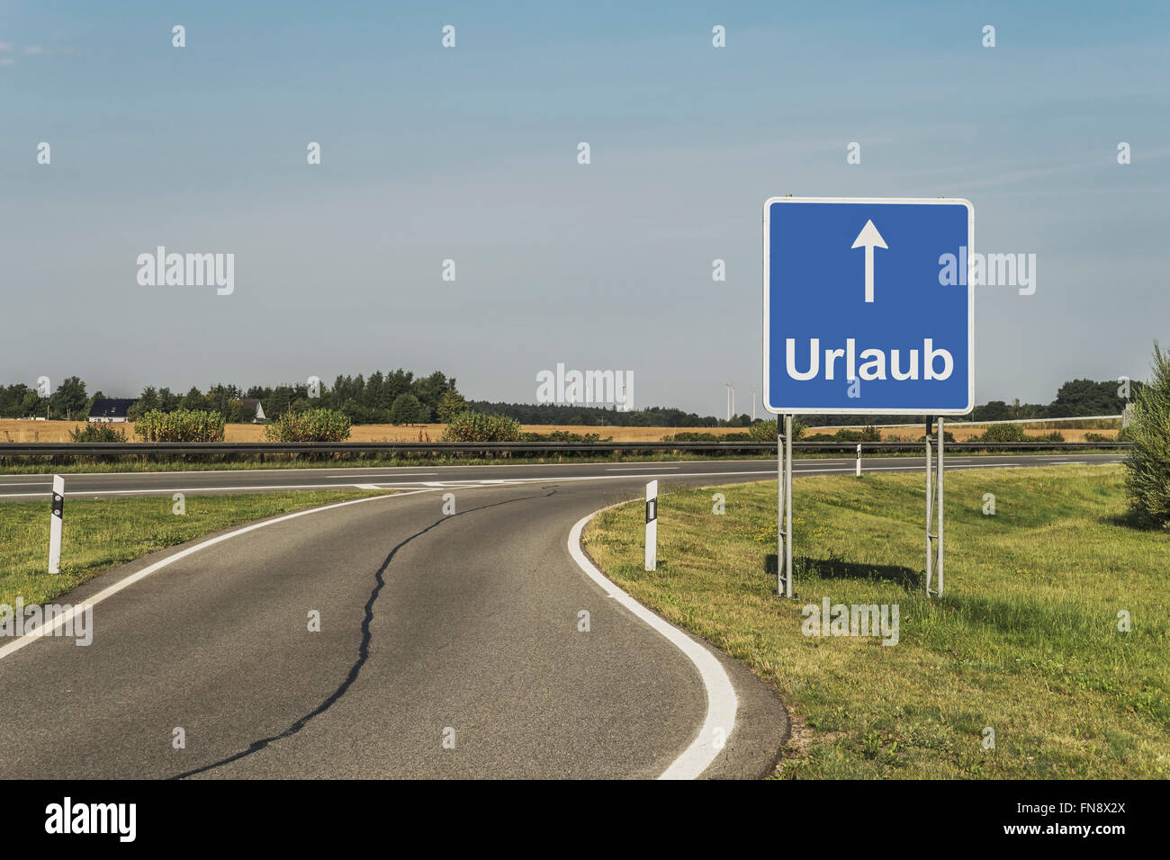 Road Sign with the German title Urlaub (holiday) on the German Highway (Autobahn), Germany, Europe - Stock Image