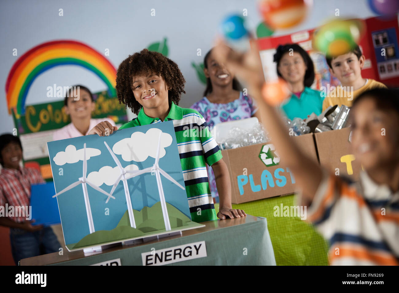 a class of children at a green science fair event with