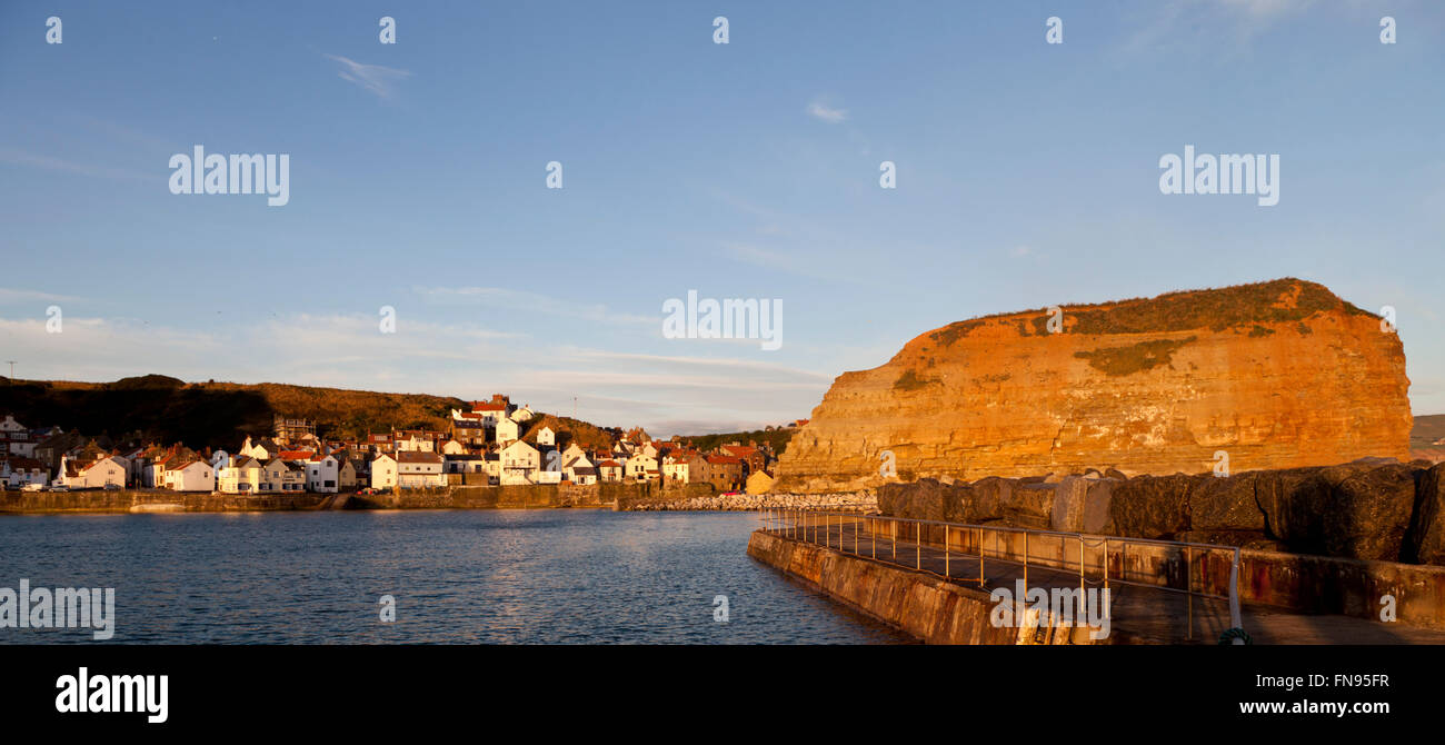 Early morning sun on Cowbar Staithes North Yorkshire - Stock Image