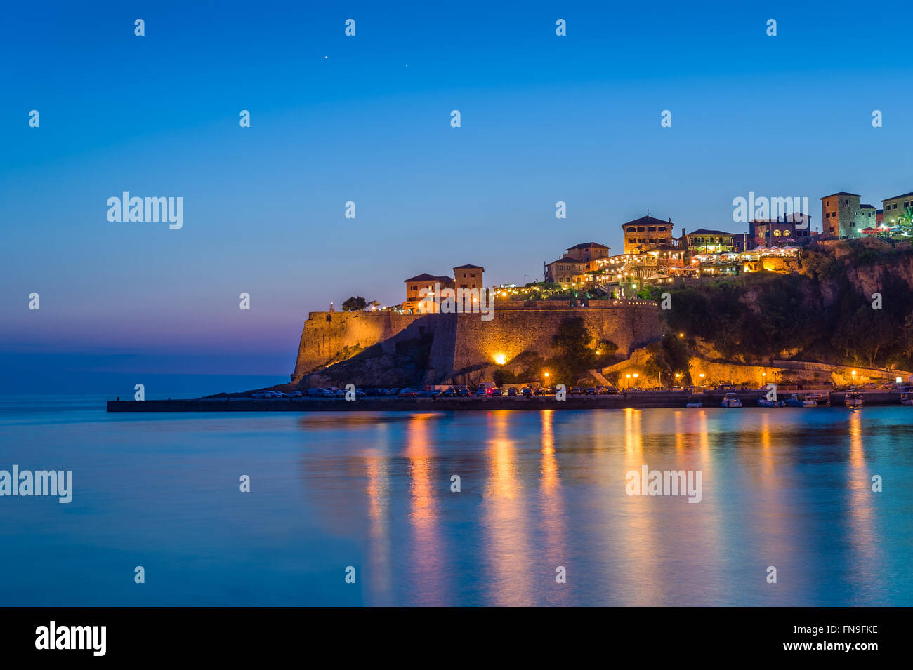 Ulcinj old town fortress at night with silky water and stars on a sky. Stock Photo