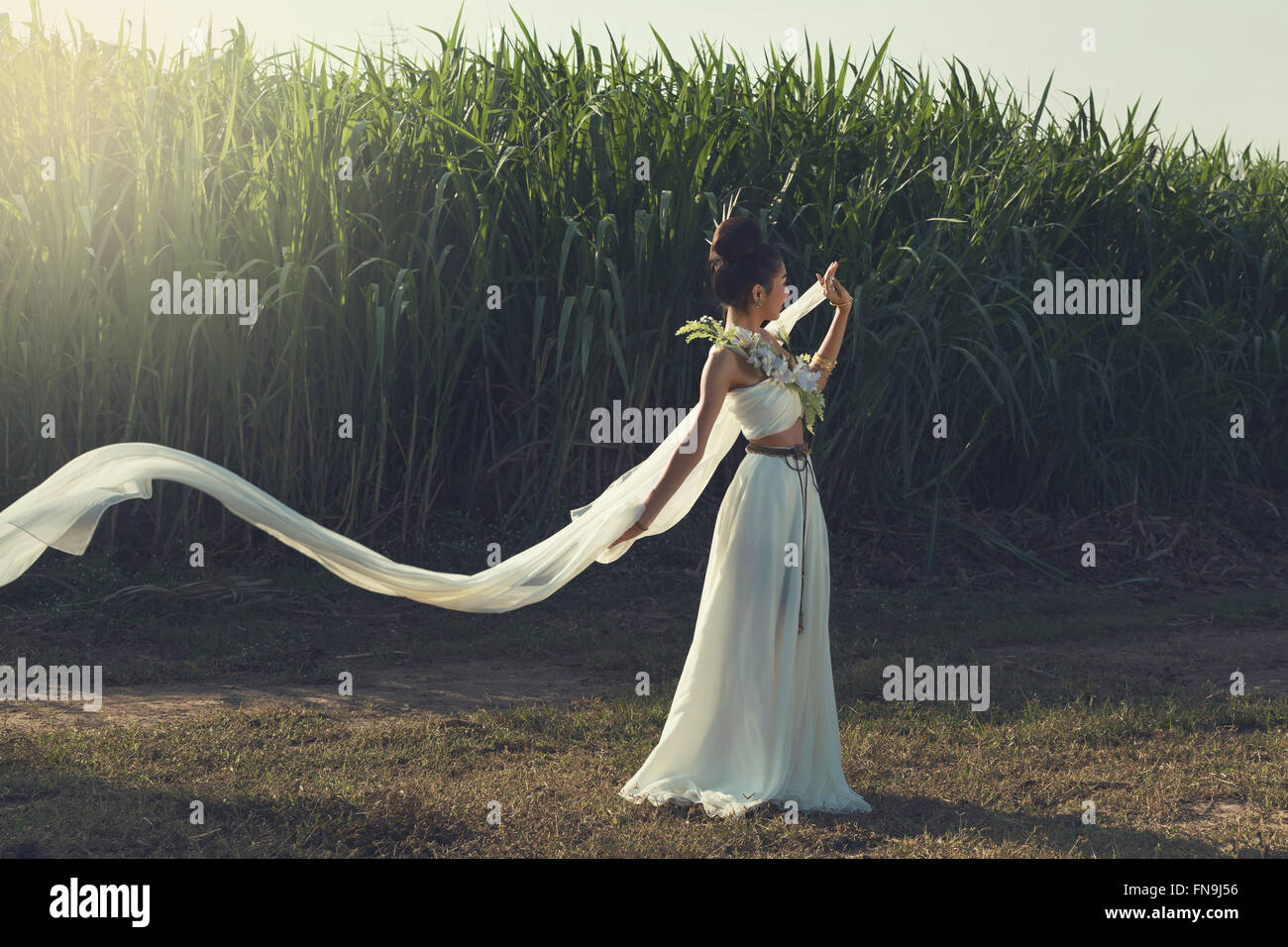Glamorous woman in white gown - Stock Image