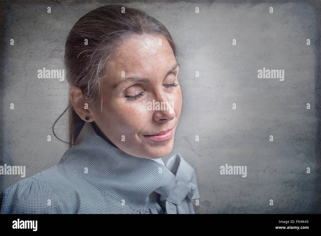 Portrait of a woman lost in thought - Stock Image