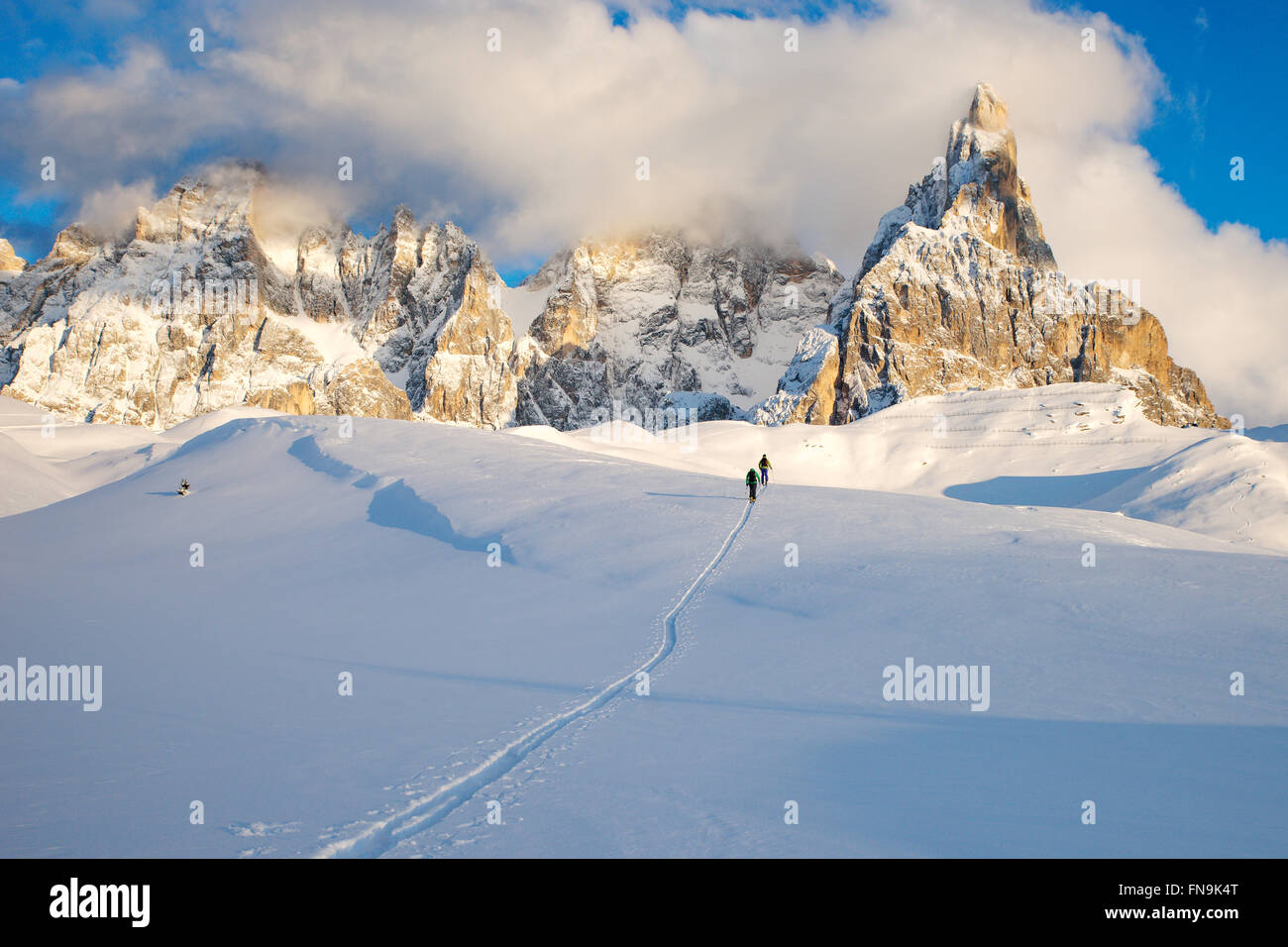 Two skiers, Dolomites, Italy - Stock Image