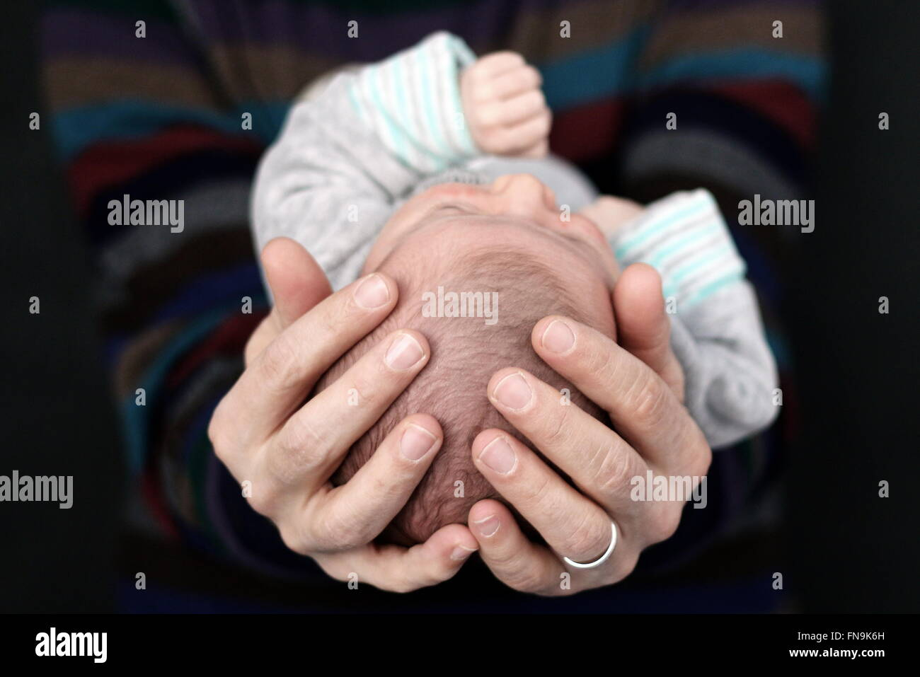 Father holding newborn baby boy - Stock Image