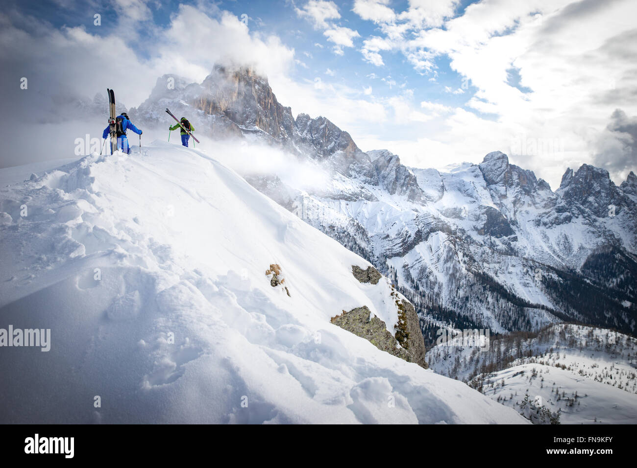 Two men Powder Skiing in Dolomites, Italy - Stock Image