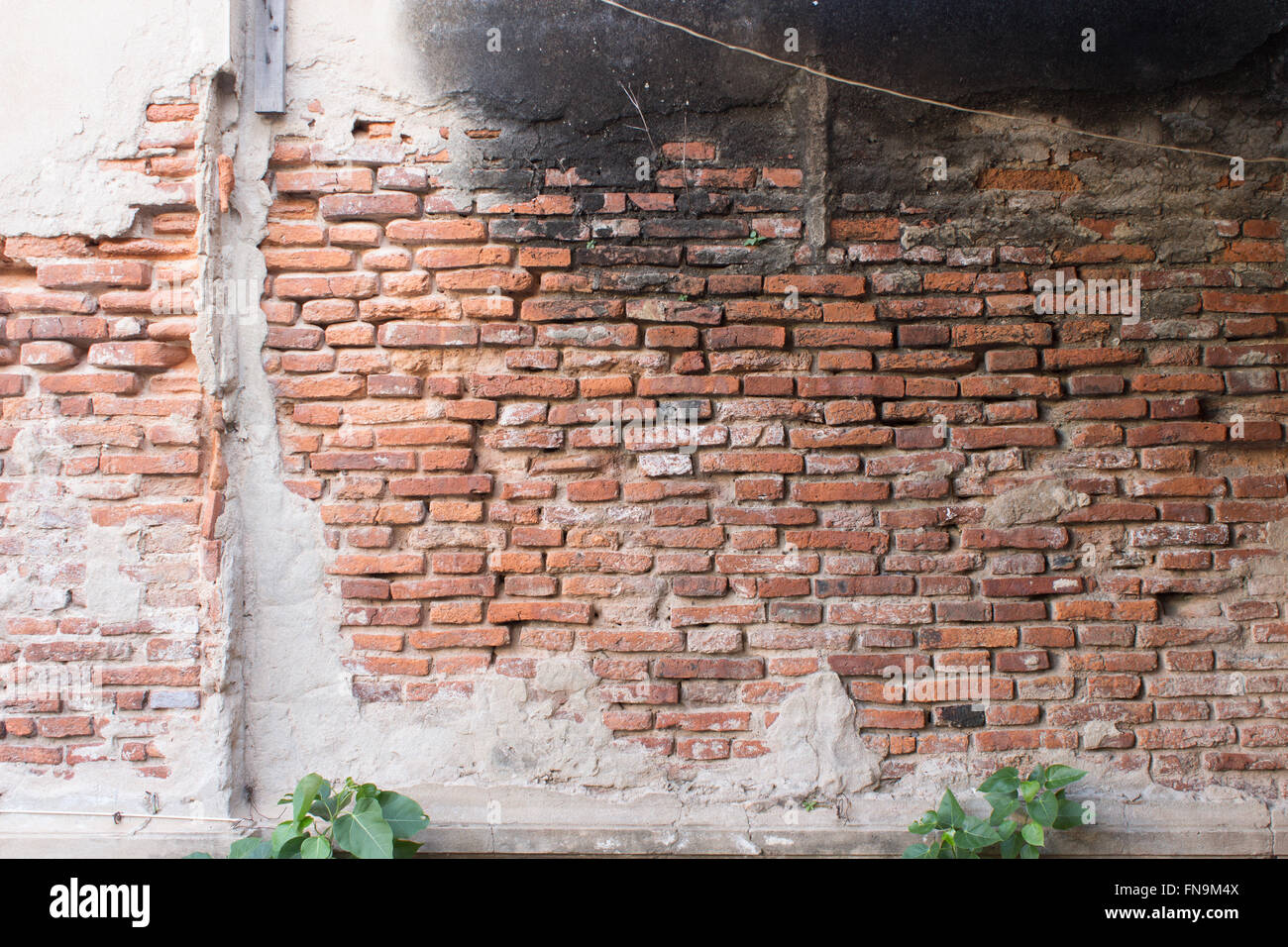 old wall with cracks background Stock Photo