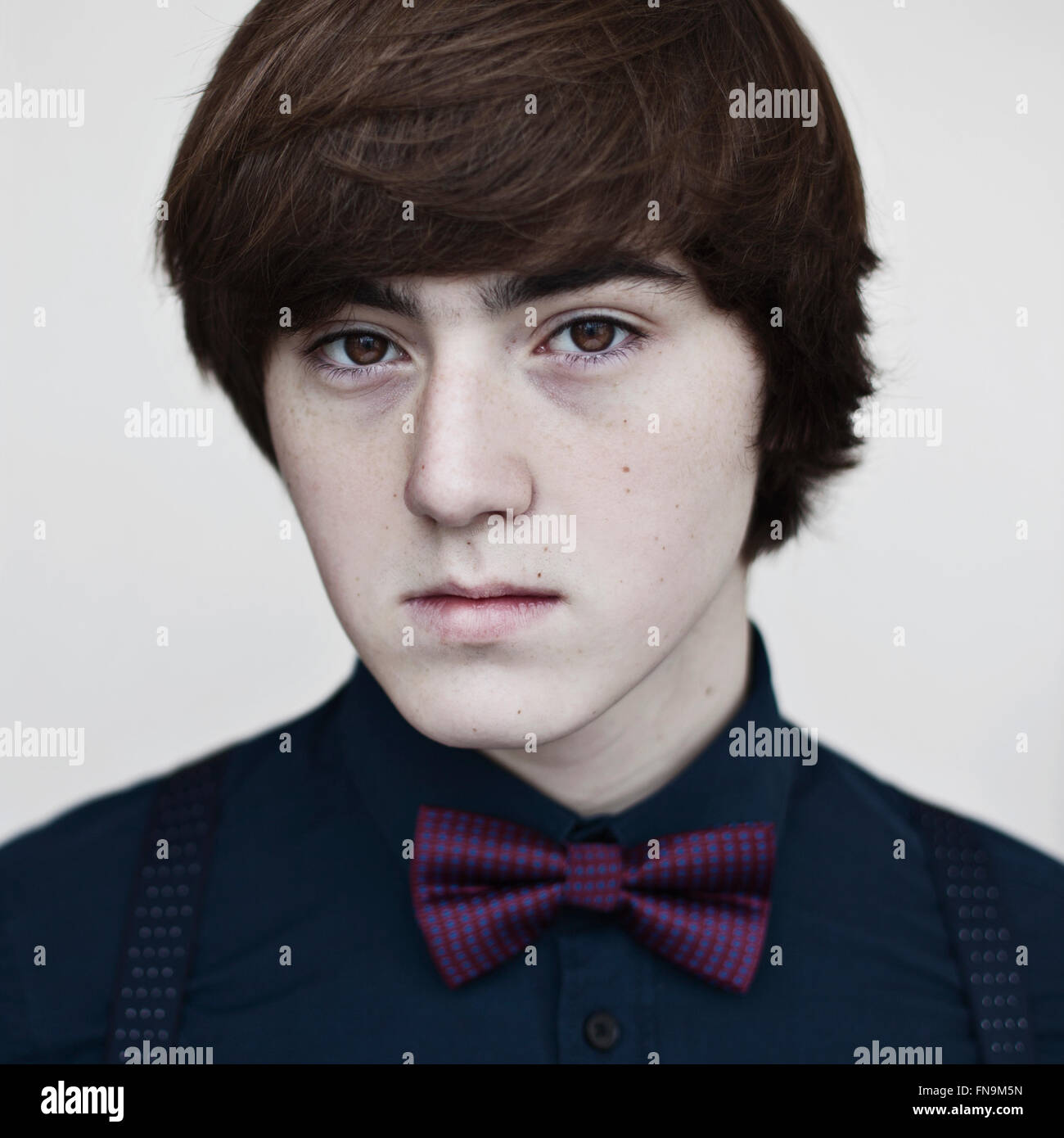 Portrait of a boy wearing a bow tie - Stock Image