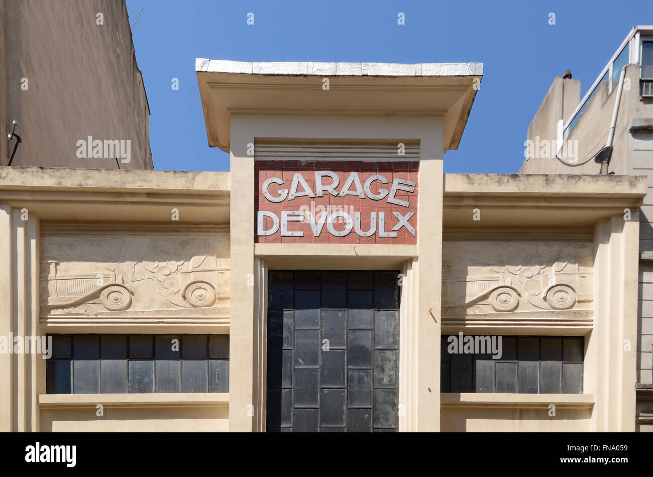 fa ade of 1920s art deco garage devoulx with bas relief or carving of stock photo 99179285 alamy. Black Bedroom Furniture Sets. Home Design Ideas