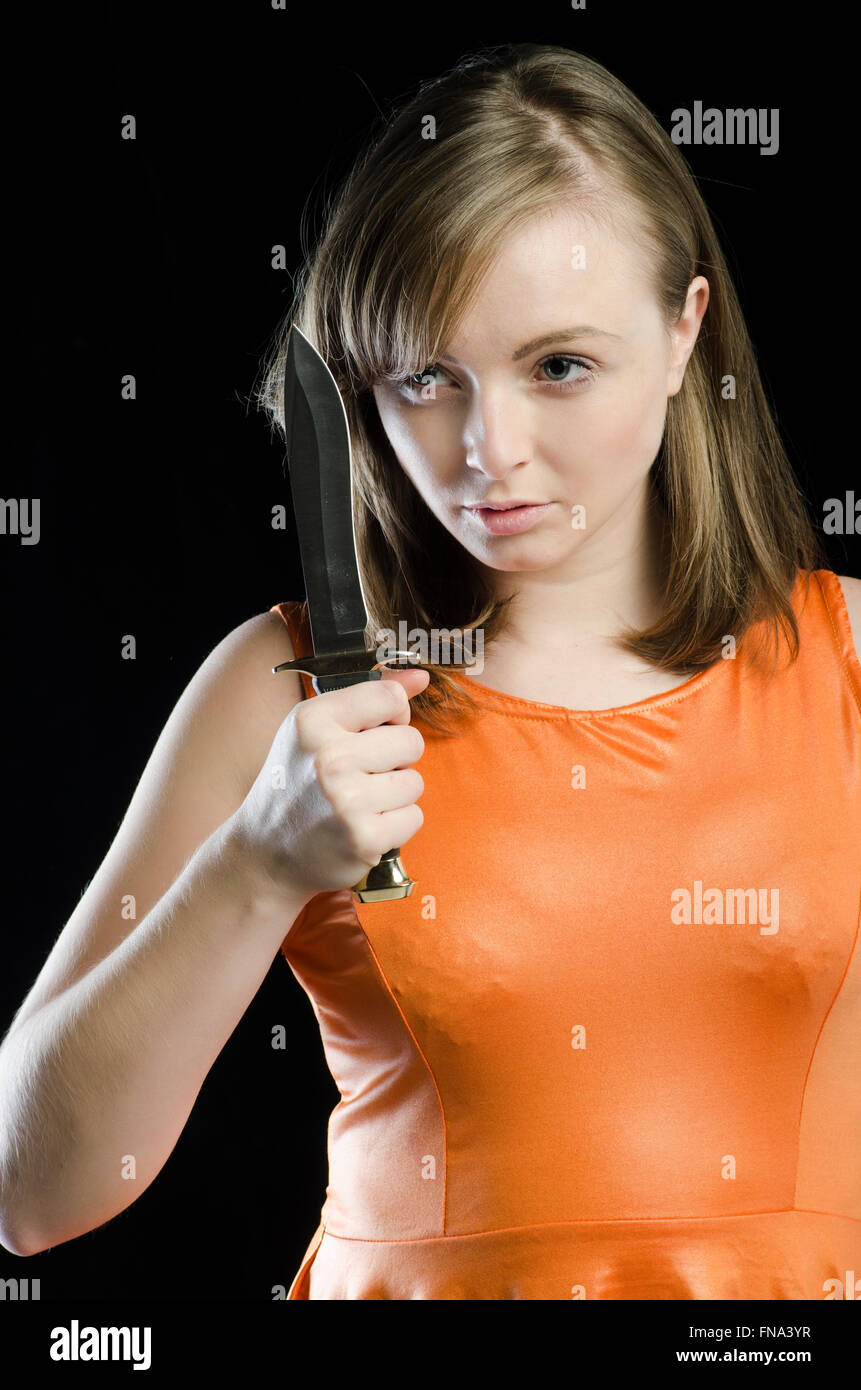 Young woman holding a dagger - Stock Image