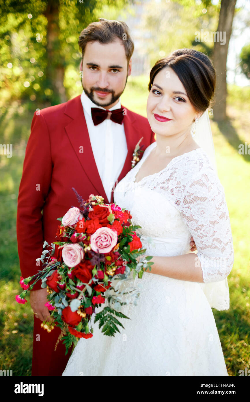 Portrait of newlyweds couple outdoors, summer. - Stock Image