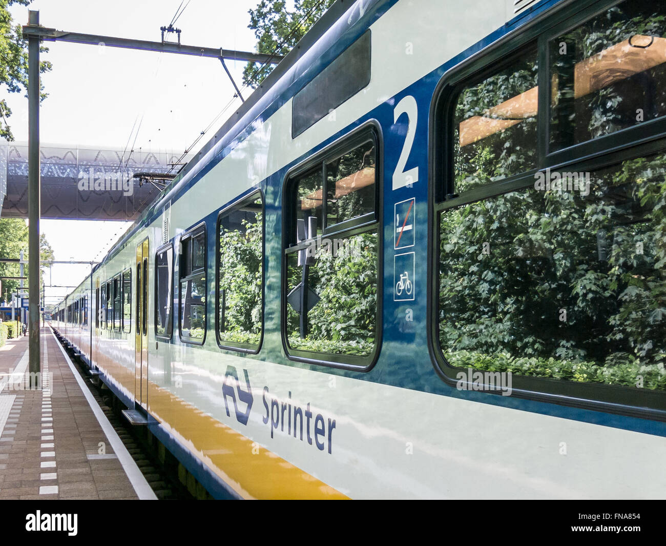 Sprinter train on railway station Mediapark in Hilversum, the Netherlands - Stock Image