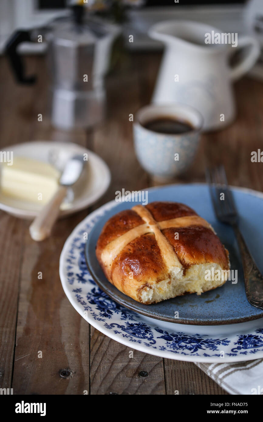 Hot cross buns on a breakfast table - Stock Image