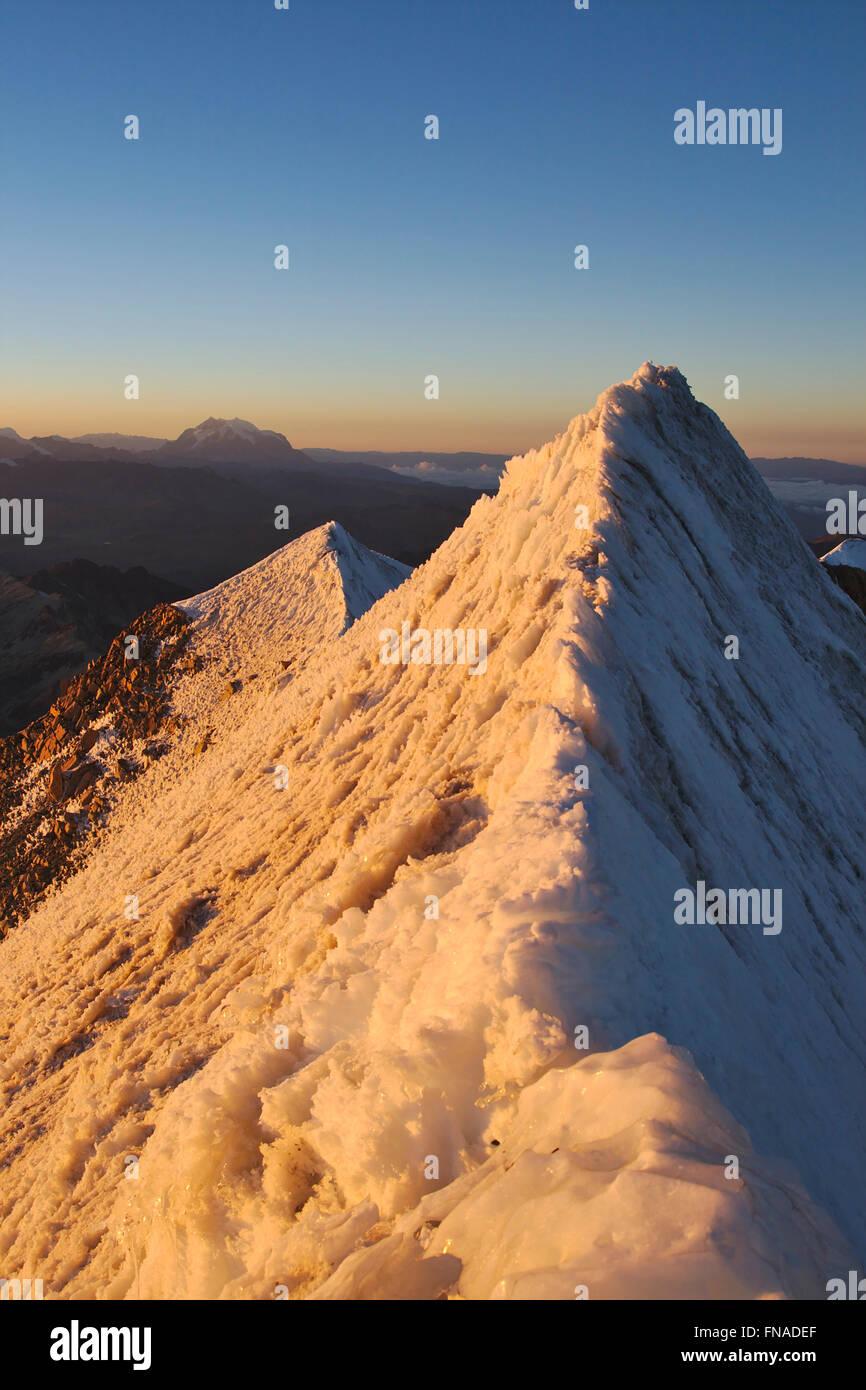 Summit ridge of Huayna Potosi in the Cordillera Real, sunrise, Illimani in the distance, Bolivia Stock Photo