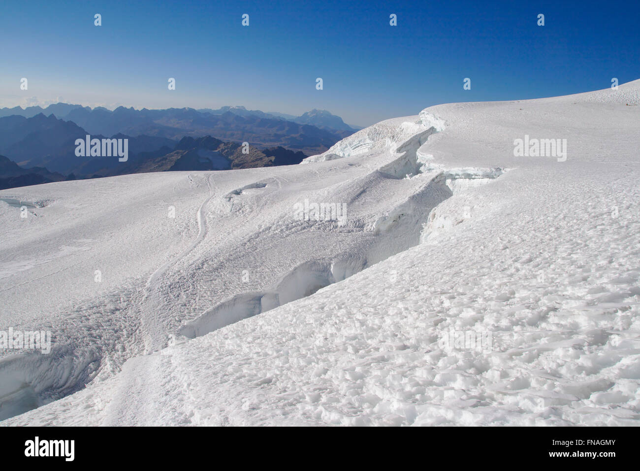 View from the glacier of Huayna Potosi over the Andes toward Illimani, Bolivia - Stock Image