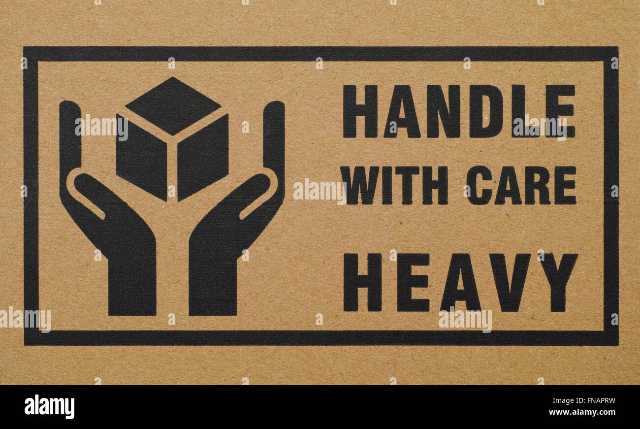 sign handle with care heavy on cardboard box stock photo 99197053