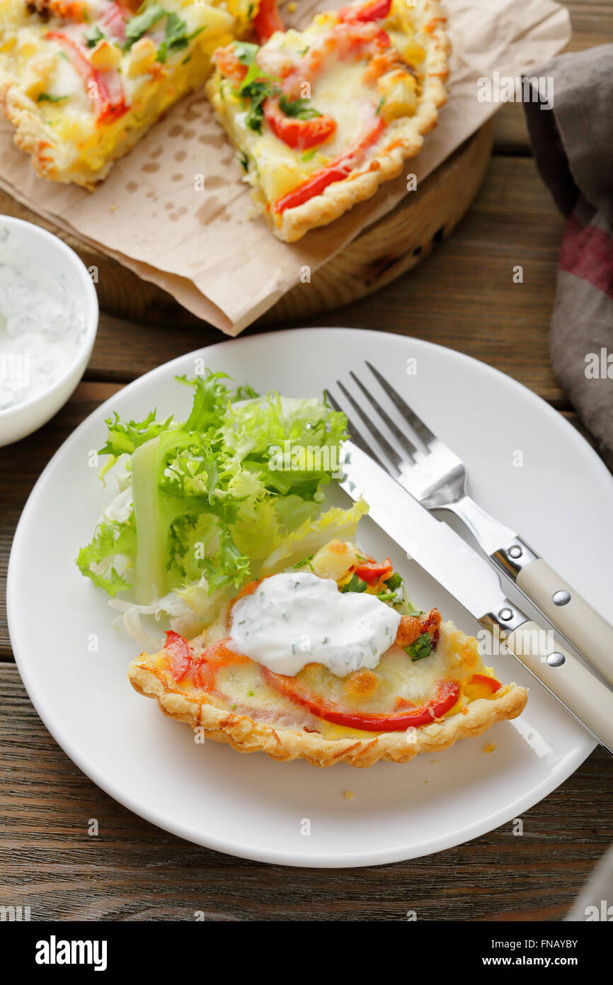 piece of salmon quiche on plate Stock Photo