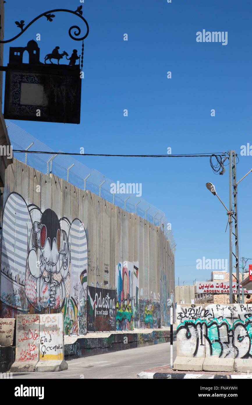 BETHLEHEM, ISRAEL - MARCH 6, 2015: The graffiti on the Separation barrier. - Stock Image