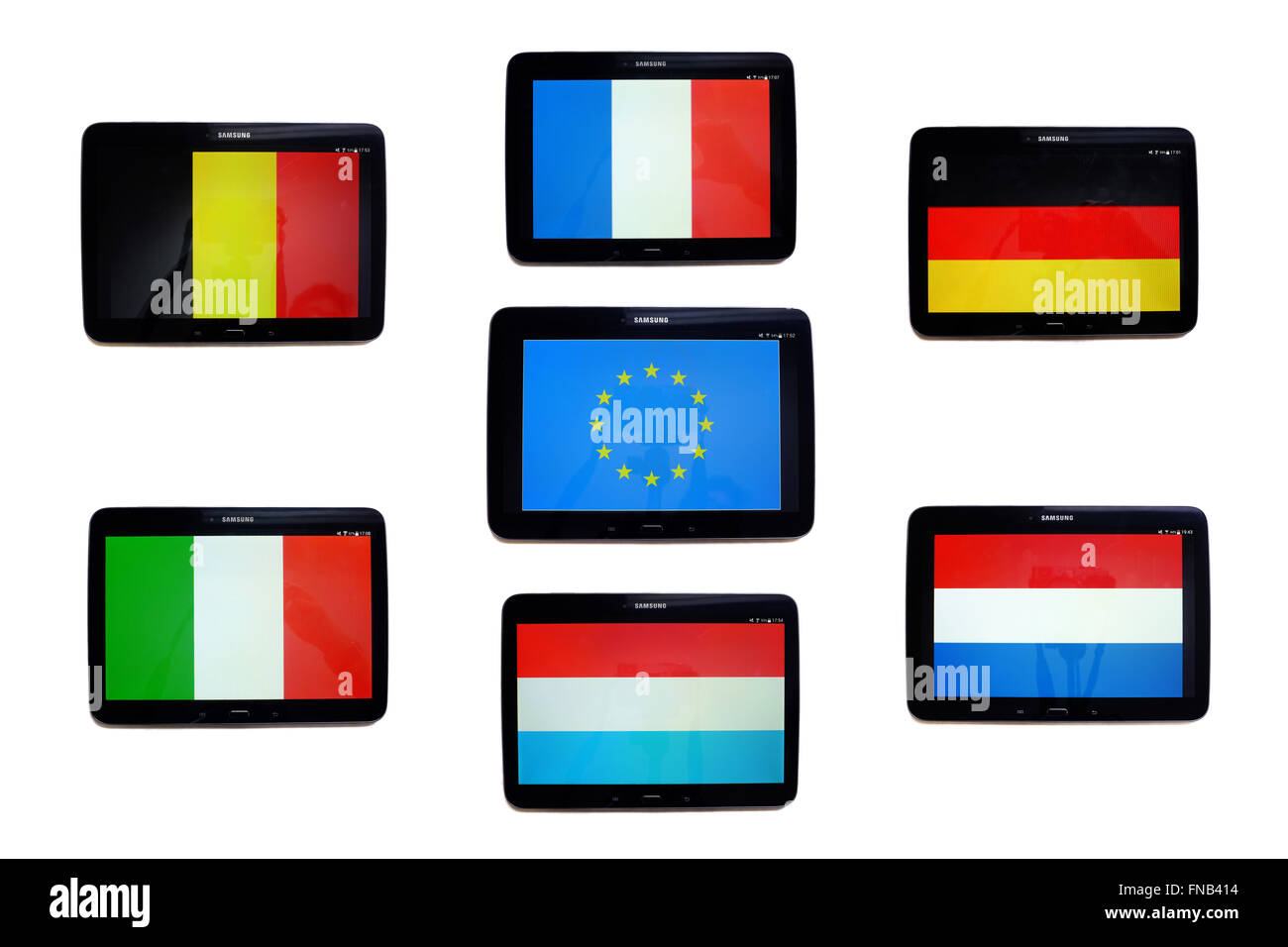The flags of the member countries of the European Union as of 1957 displayed on the screens of tablets. - Stock Image