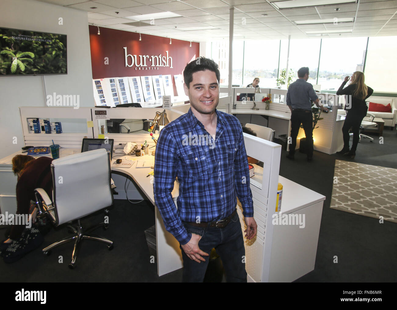 Los Angeles, California, USA. 3rd Feb, 2016. Oren Castro, co-founder of Burnish Creative at his firm's new office - Stock Image