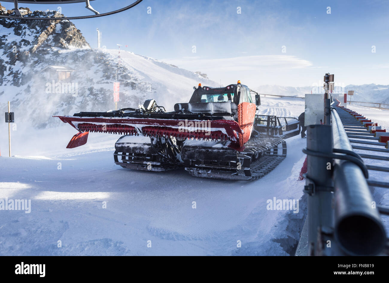 Snow Groomer in windy conditions Stock Photo