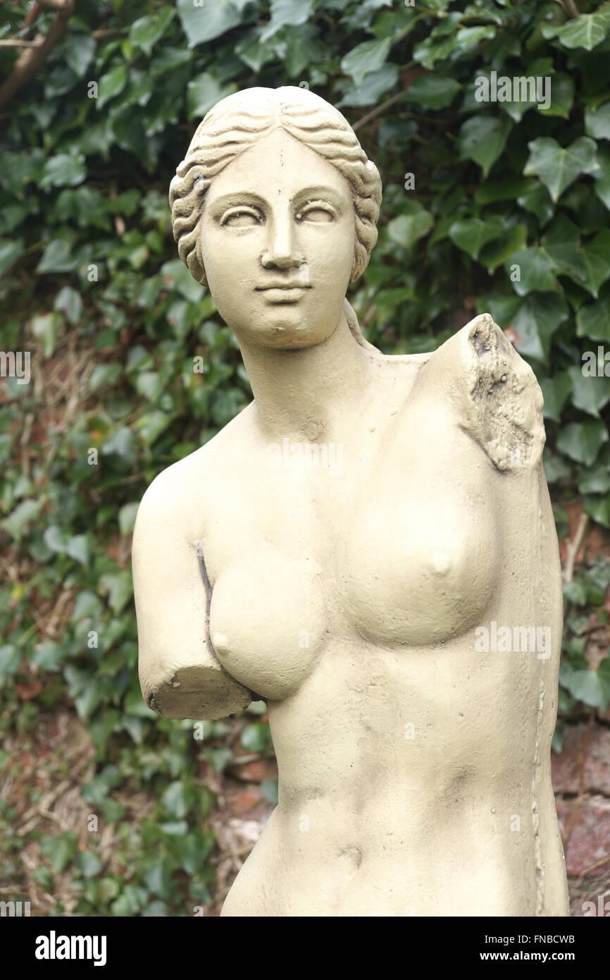 Copy of the famous Venus de Milo statue in a garden setting - Stock Image