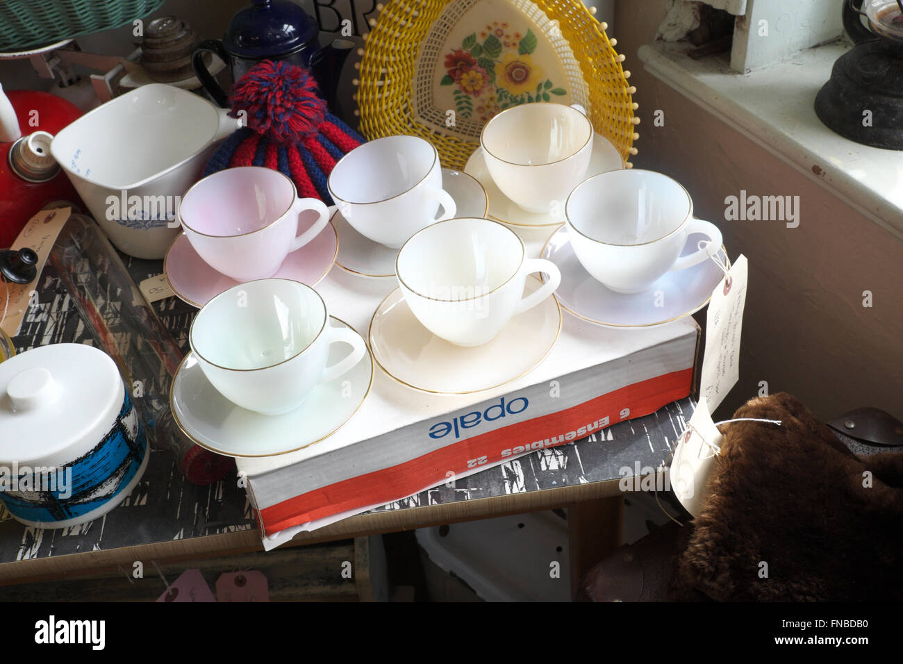 Set of Opale cups and saucers from the 1960s for sale in a vintage retro antique shop store in Leominster Herefordshire - Stock Image