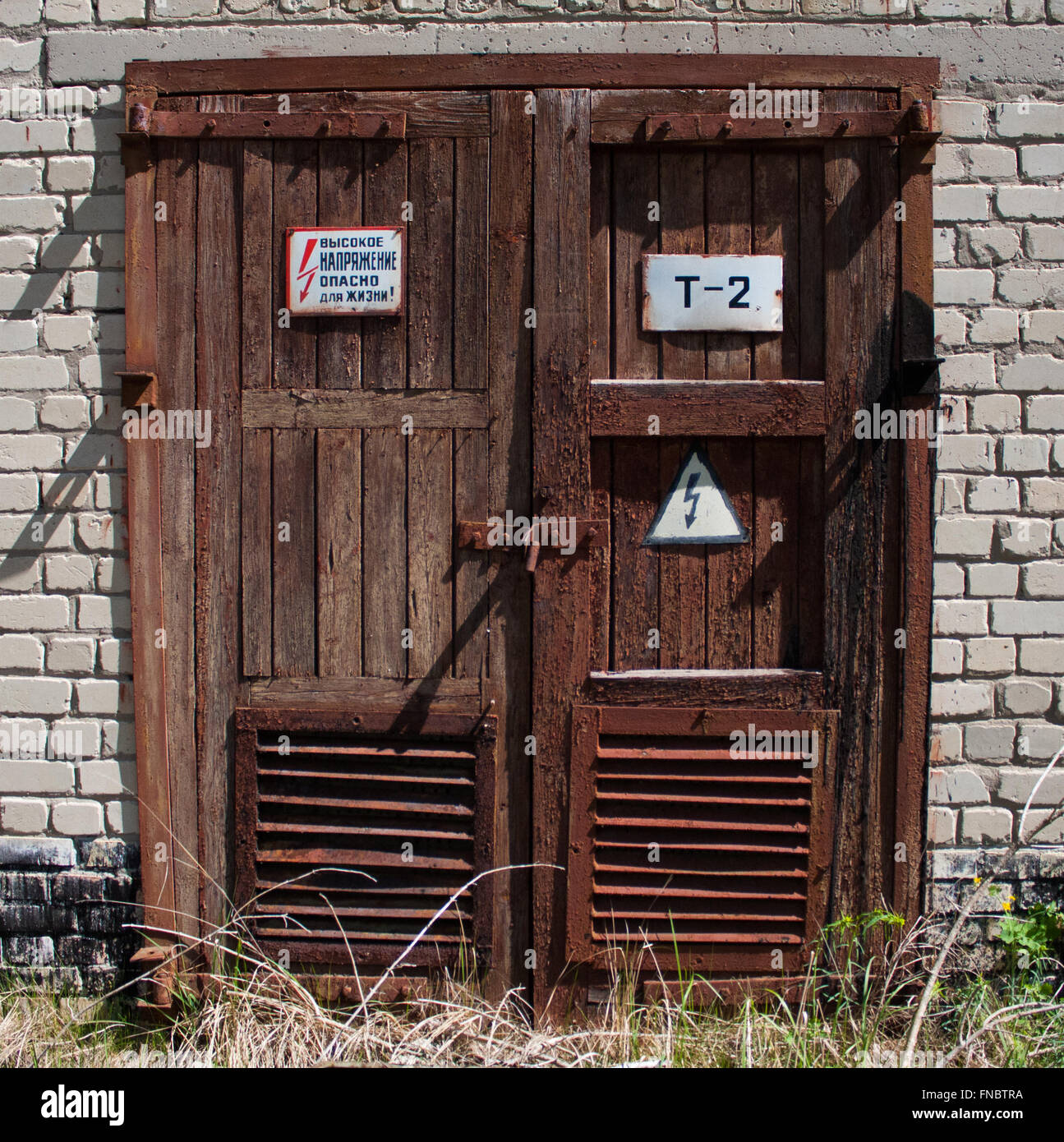 Old doors in Chernobyl secluded area - Stock Image