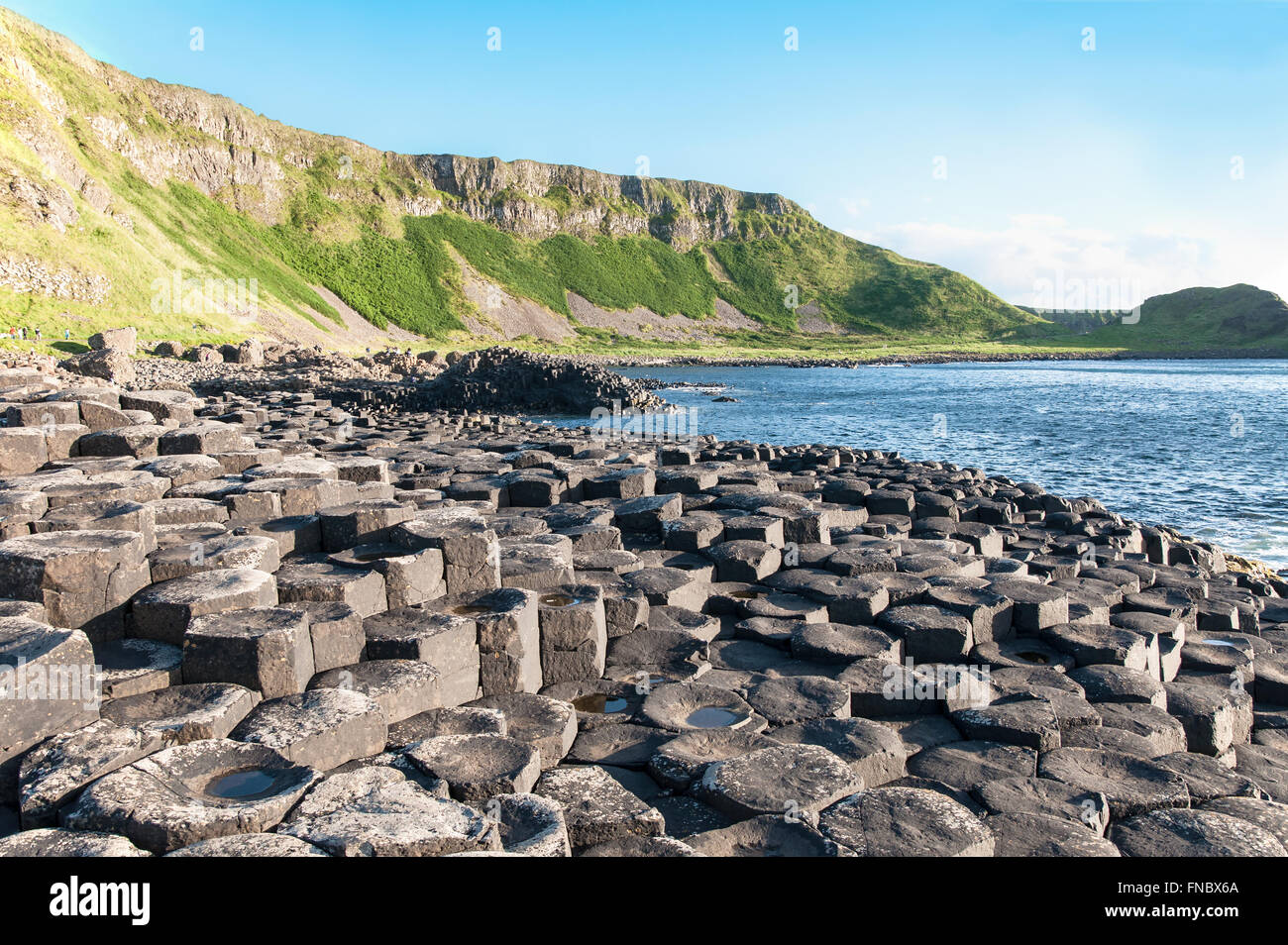 Giants Causeway, unique geological formation of rocks and cliffs in Antrim County, Northern Ireland, in sunset light - Stock Image