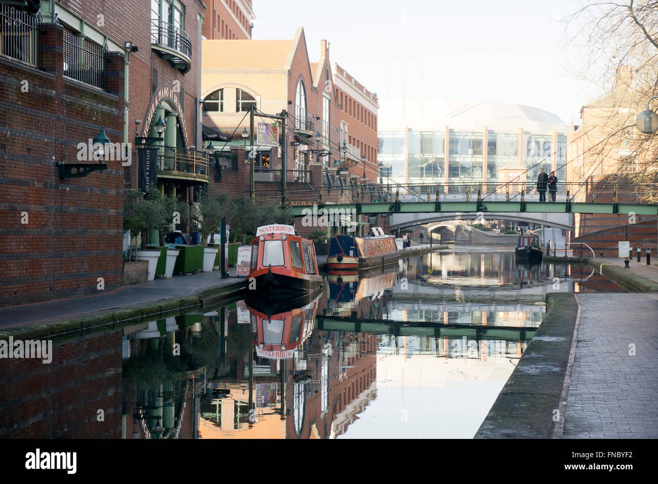 Narrowboats on the canal at Brindley Place Birmingham, England, UK - Stock Image
