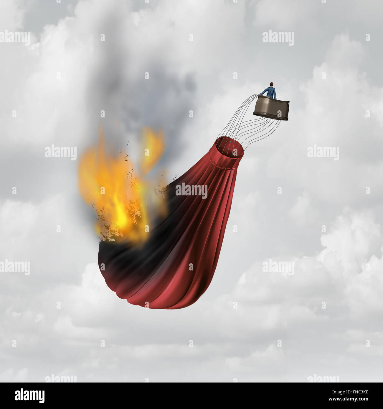 Business distress concept and financial problem symbol as a businessman in a burning falling hot air balloon that - Stock Image