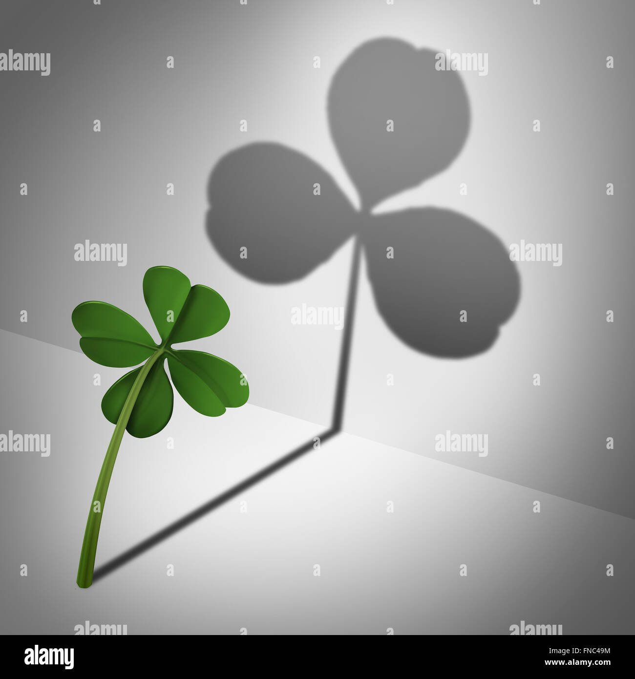 Low self esteem psychological concept as a four leaf clover casting a shadow with only three leaves as a mental - Stock Image