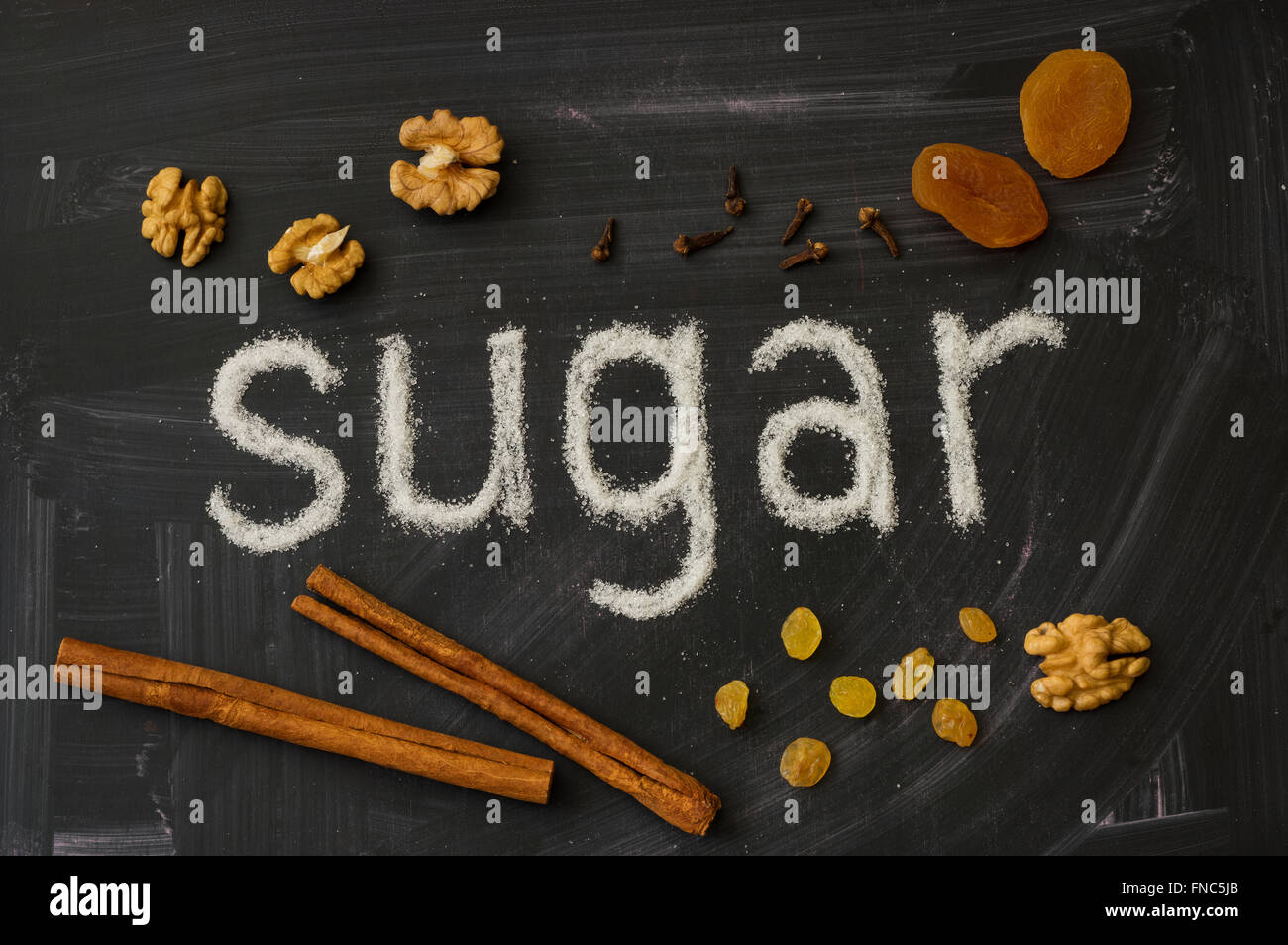 Word made of sugar describe SUGAR, decorated with spices, cinnamon, raisin and walnuts - Stock Image
