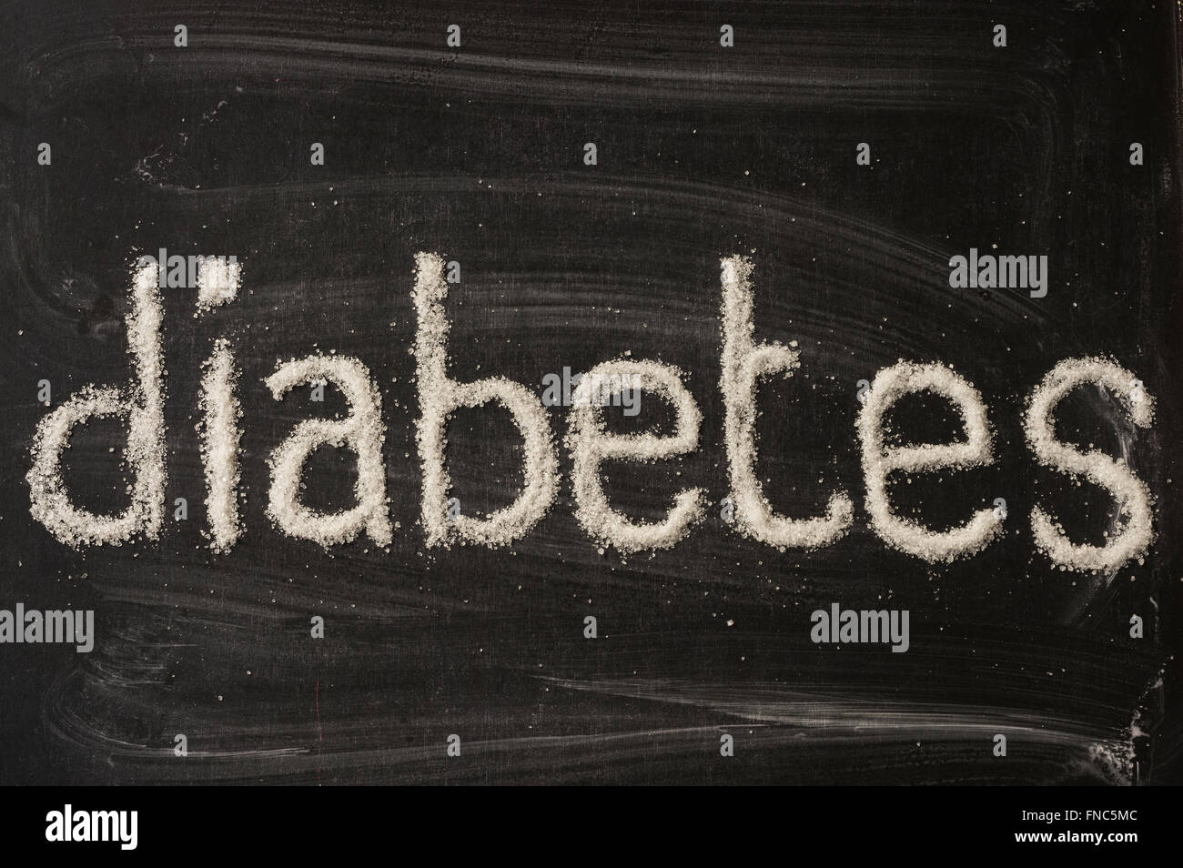 Diabetes word written with sugar on blackboard - Stock Image