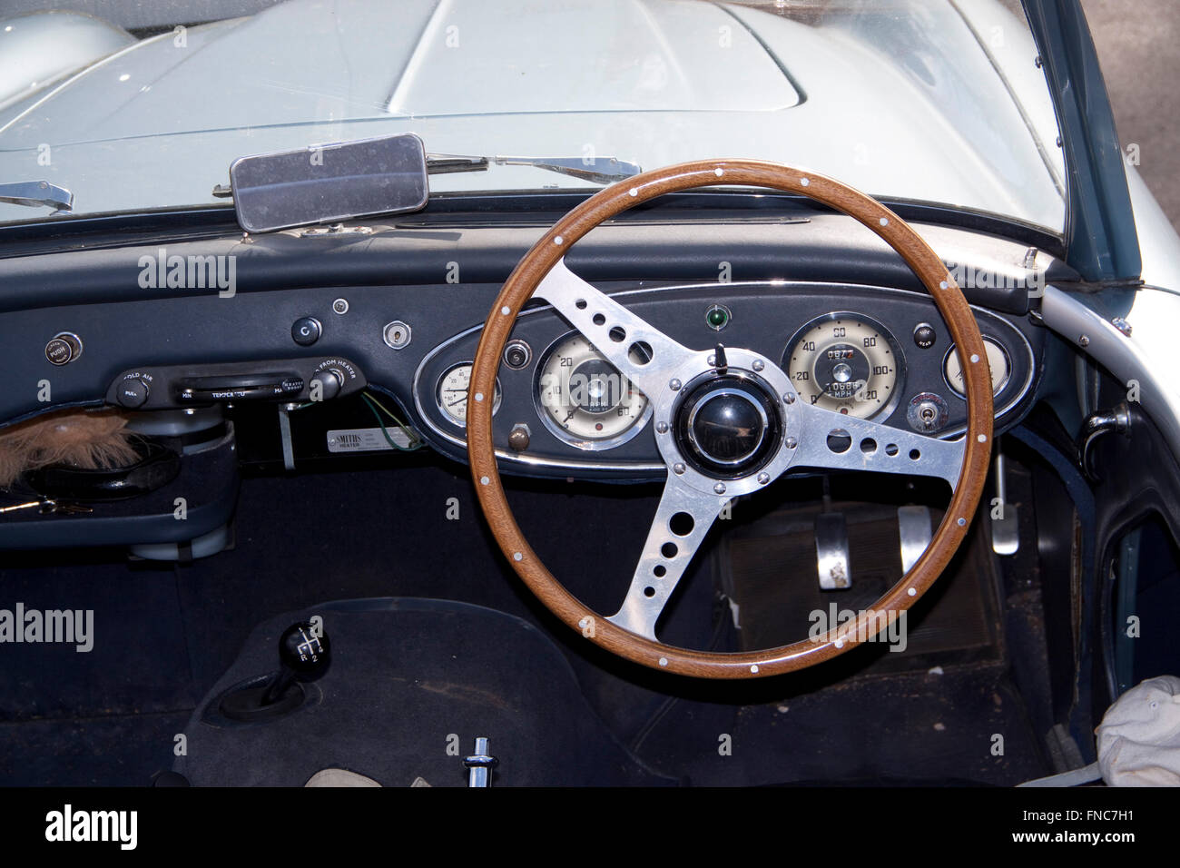 Wooden Steering Wheel And Cream Coloured Colored Instruments On The