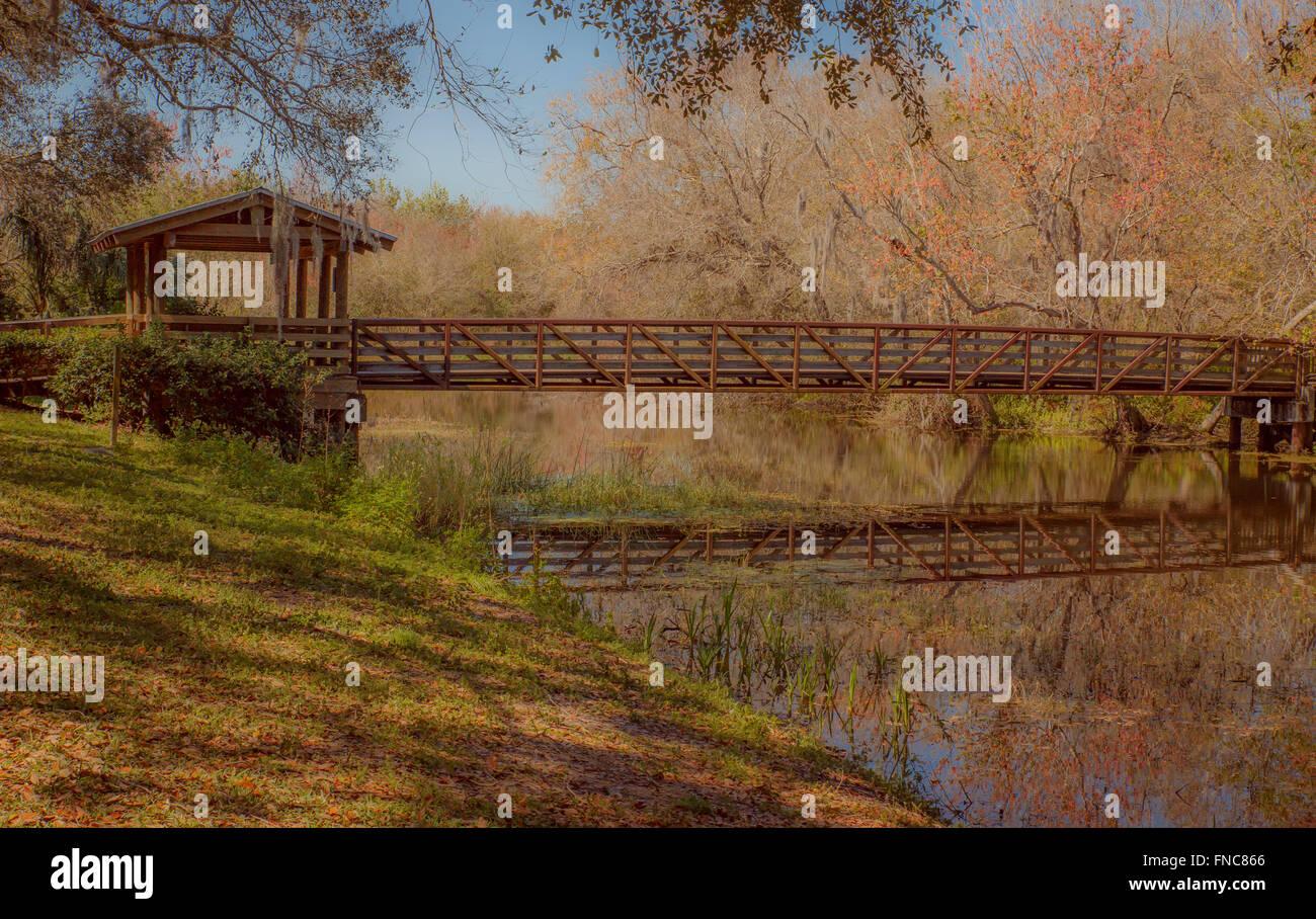 Reflection - Gazebo and footbridge at Sawgrass Lake Park, Florida - Stock Image