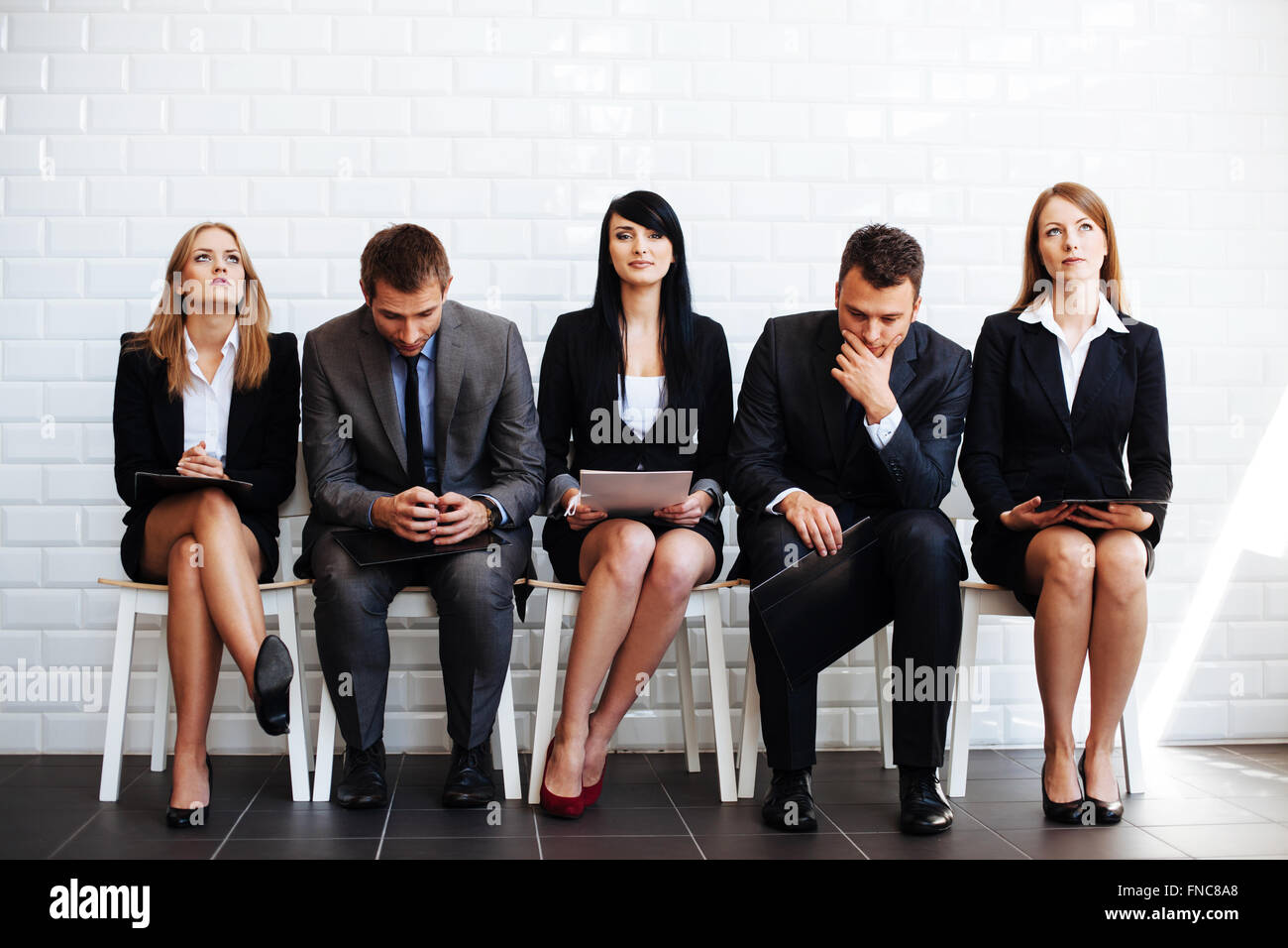 Standing out from crowd, confident business woman waiting for job interview - Stock Image