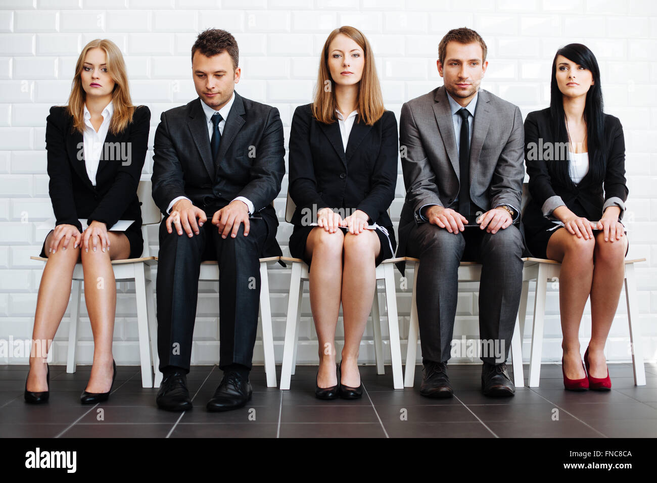Stressed business people wiating for job interview - Stock Image