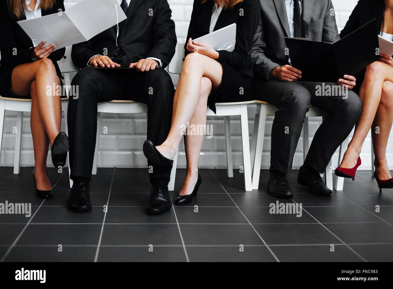 Group of business people waiting in waiting room - Stock Image