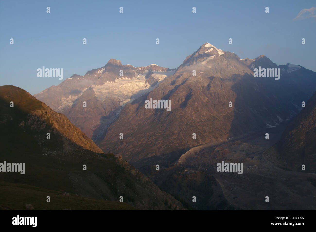 Aiguille de Tre la Tete, morning light, Mont Blanc Massif, from an Alp above Val Veny, Italy - Stock Image