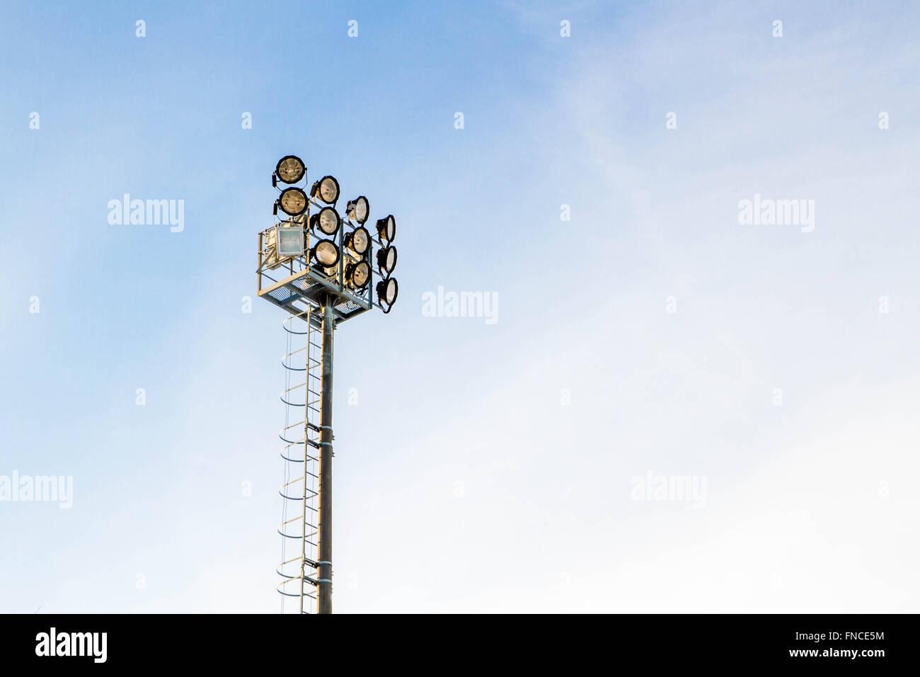 floodlights to illuminate the stadium - Stock Image
